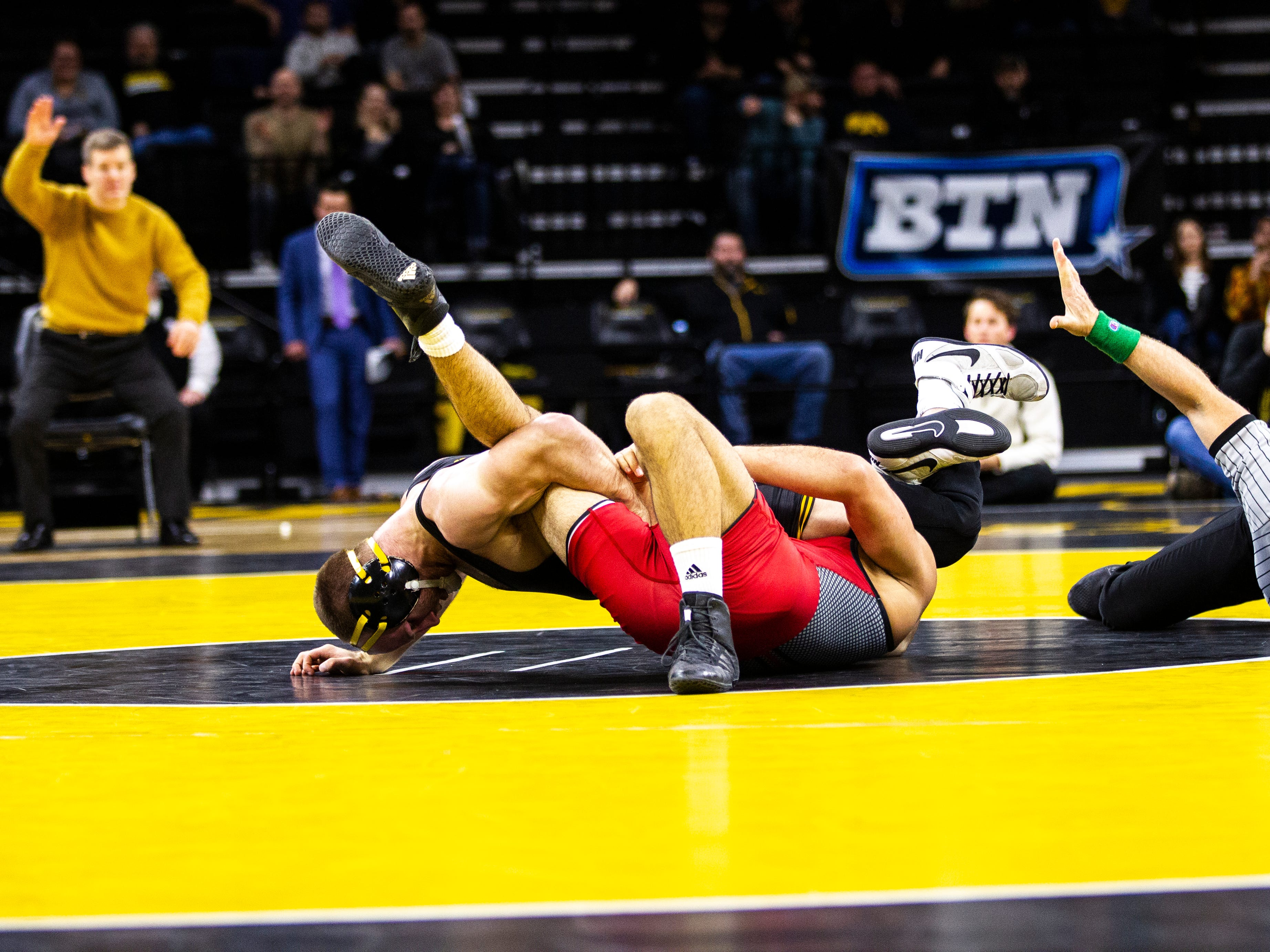 Iowa's Alex Marinelli pins Rutgers' Anthony Oliveri at 165 during a NCAA Big Ten Conference wrestling dual on Friday, Jan. 18, 2019, at Carver-Hawkeye Arena in Iowa City, Iowa.