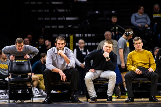 Iowa's Terry Brands, Bobby Telford, Ryan Morningstar and Tom Brands look on during a NCAA Big Ten Conference wrestling dual on Friday, Jan. 18, 2019, at Carver-Hawkeye Arena in Iowa City, Iowa.