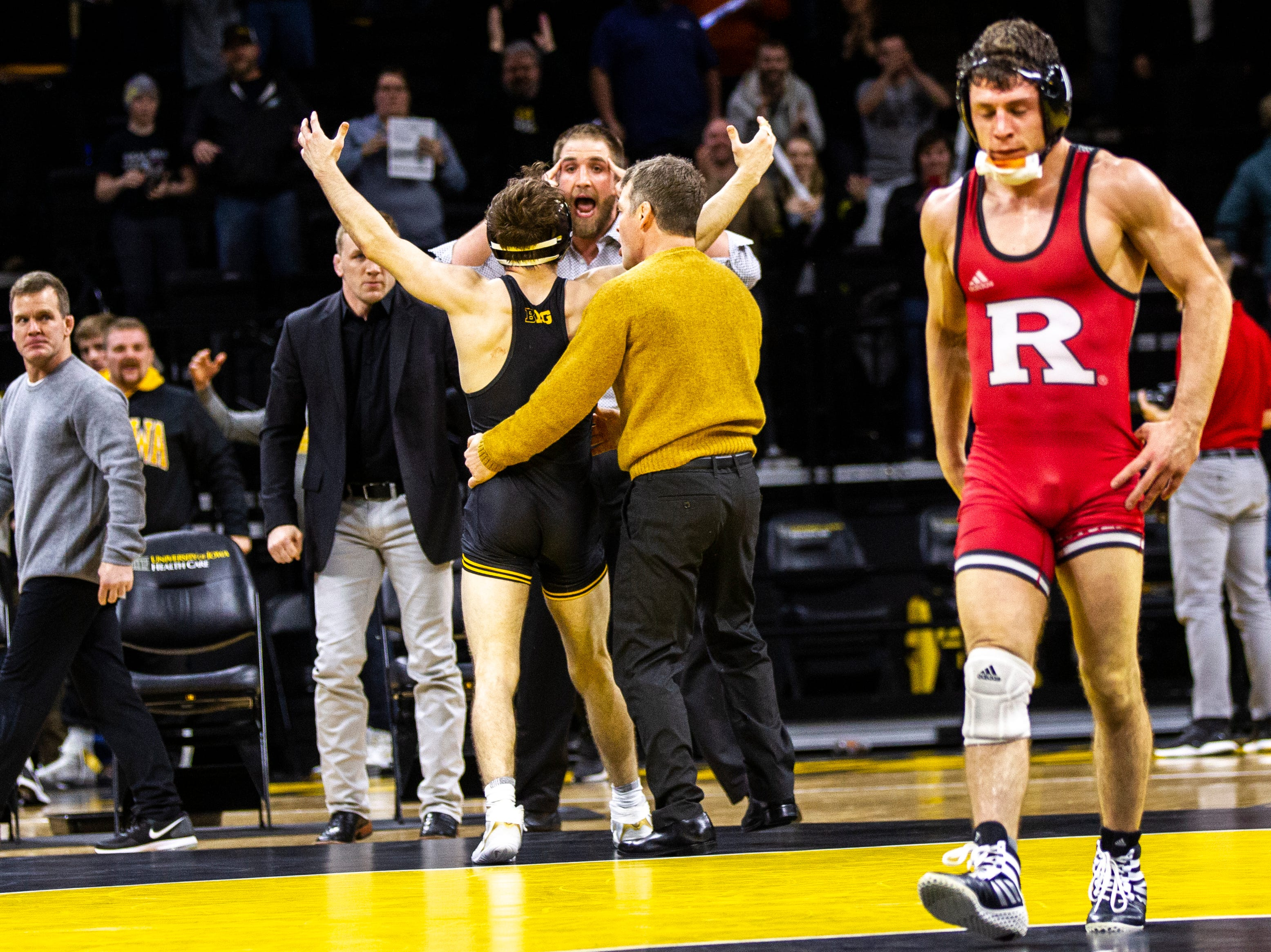 Iowa's Austin DeSanto, left, celebrates after scoring a decision over Rutgers' Nick Suriano at 133 during a NCAA Big Ten Conference wrestling dual on Friday, Jan. 18, 2019, at Carver-Hawkeye Arena in Iowa City, Iowa.