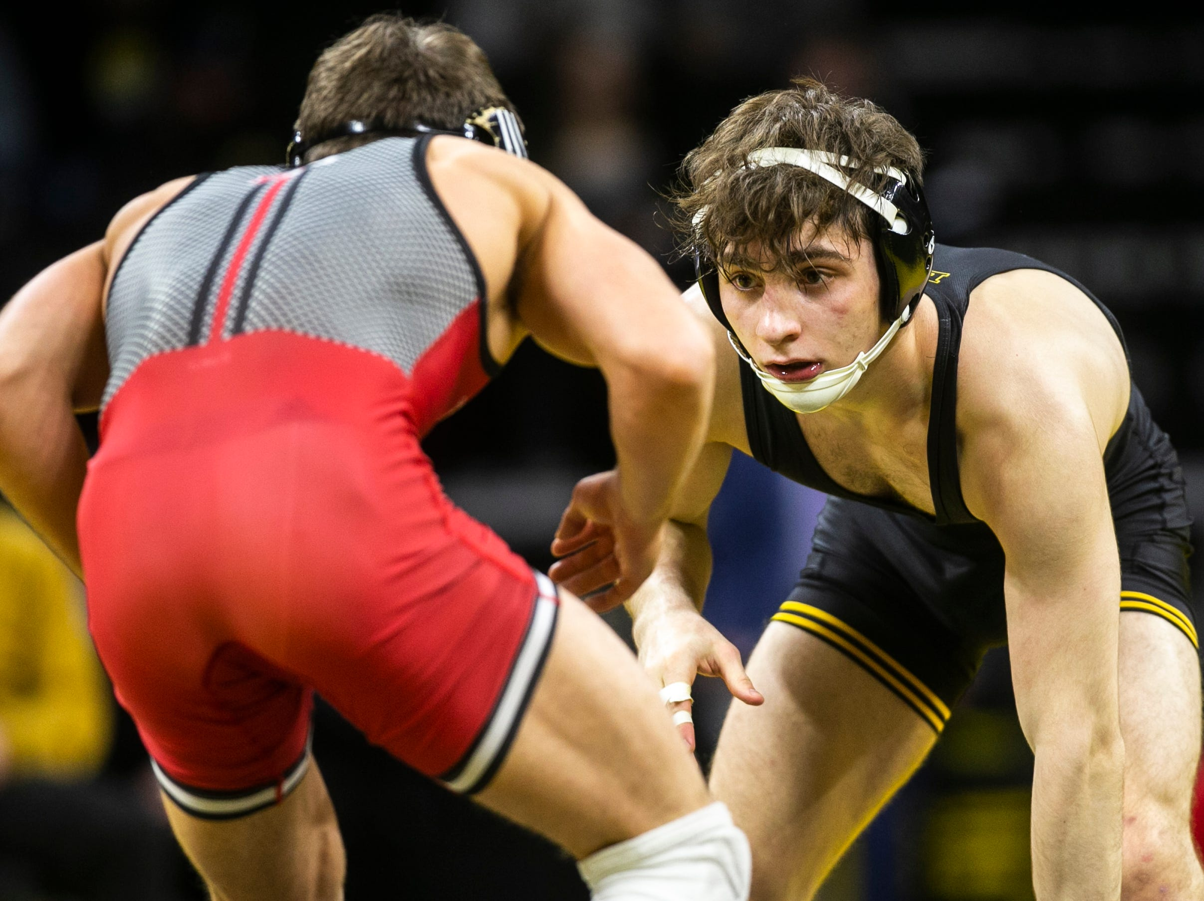 Iowa's Austin DeSanto, right, wrestles Rutgers' Nick Suriano at 133 during a NCAA Big Ten Conference wrestling dual on Friday, Jan. 18, 2019, at Carver-Hawkeye Arena in Iowa City, Iowa.