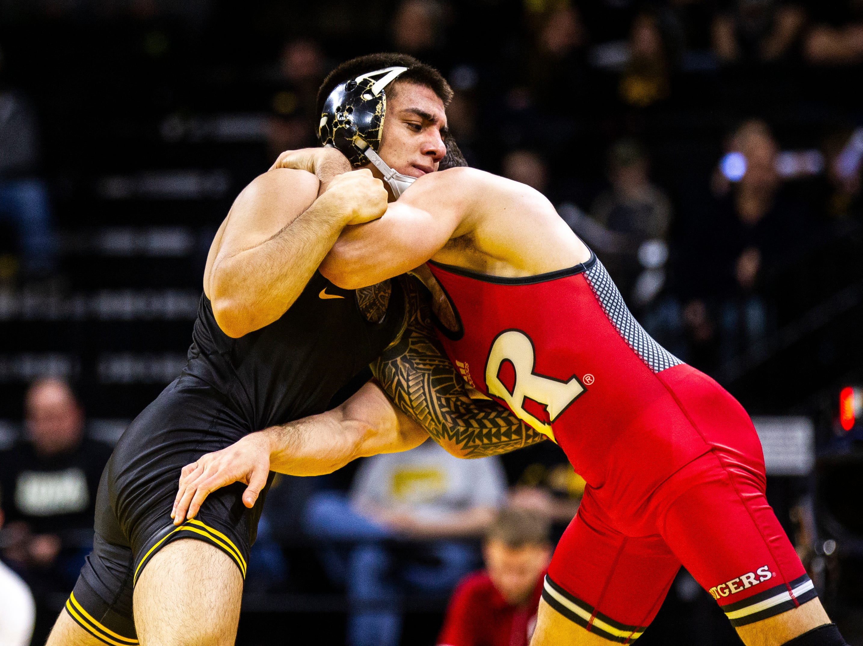 Iowa's Pat Lugo, left, wrestles Rutgers' Anthony Ashnault at 149 during a NCAA Big Ten Conference wrestling dual on Friday, Jan. 18, 2019, at Carver-Hawkeye Arena in Iowa City, Iowa.