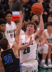 Zionsville senior Ben Alcock (20) puts up a shot against HSE on Friday night.