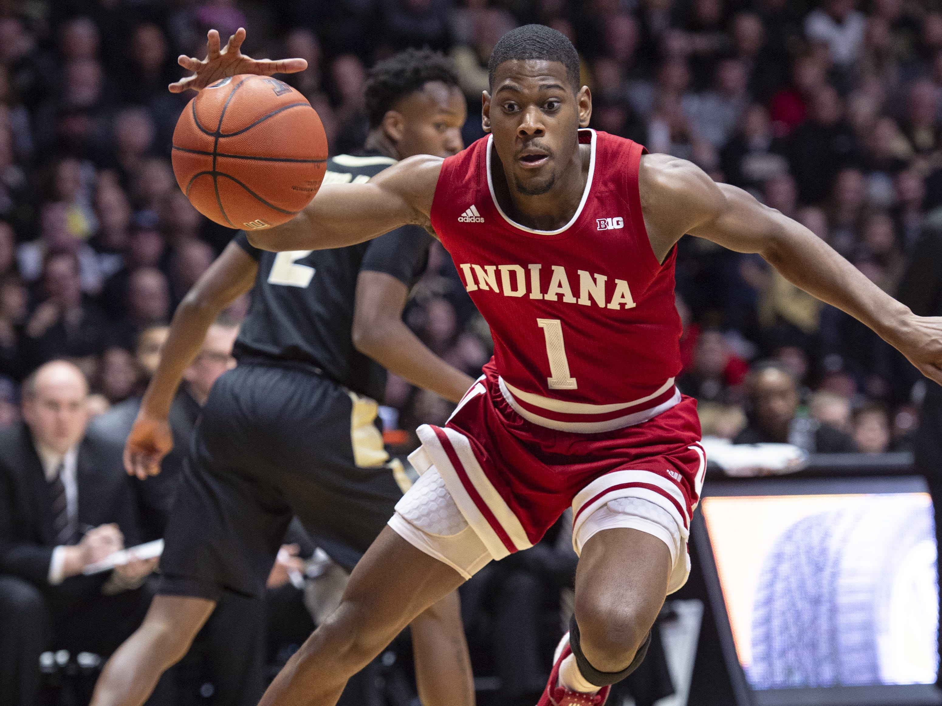 Indiana Hoosiers guard Aljami Durham (1) makes a move toward the basket during the first half against Purdue.