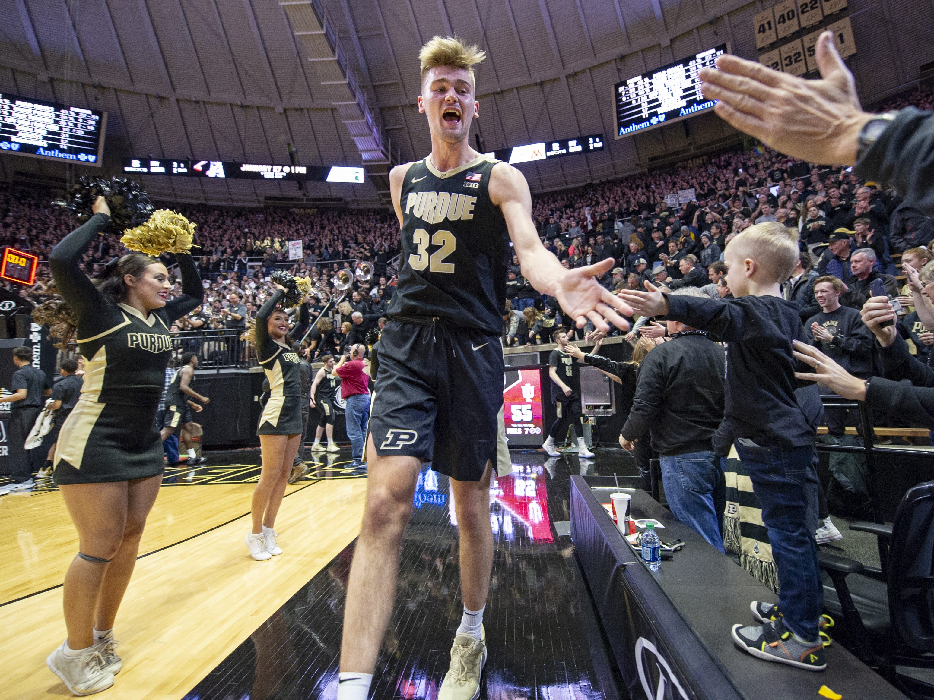 Purdue Boilermakers center Matt Haarms (32) celebrates the team's victory over Indiana with fans.
