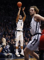 Butler Bulldogs forward Jordan Tucker (1) puts up a three-pointer in the first half of their game at Hinkle Fieldhouse Saturday, Jan. 19, 2019.