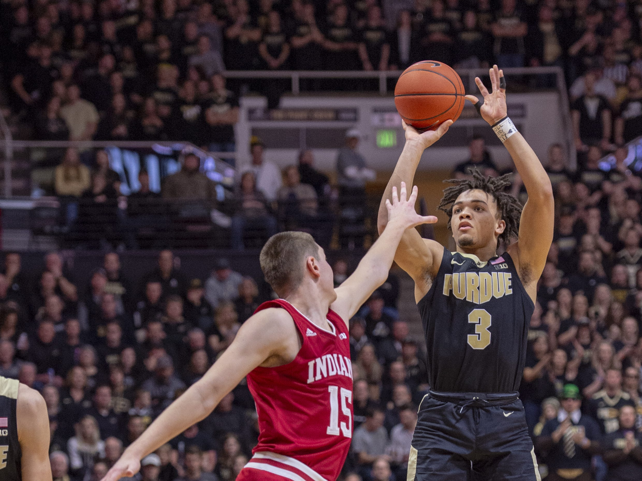 Purdue Boilermakers guard Carsen Edwards (3) puts up a shot over the defense of Indiana Hoosiers guard Zach McRoberts (15) during the second half.