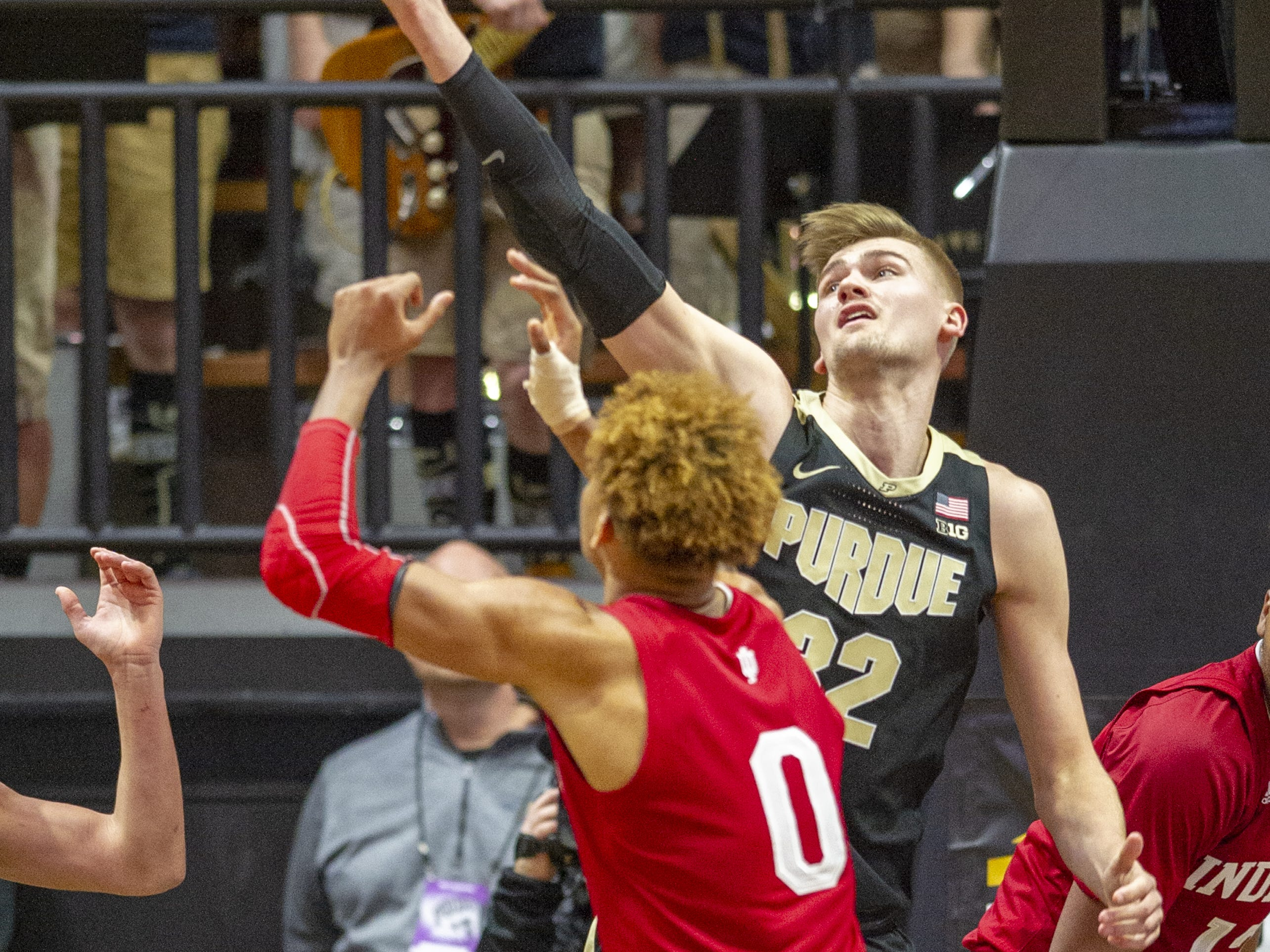 Purdue Boilermakers center Matt Haarms (32) goes after a rebound with Indiana Hoosiers guard Romeo Langford (0) during the second half.