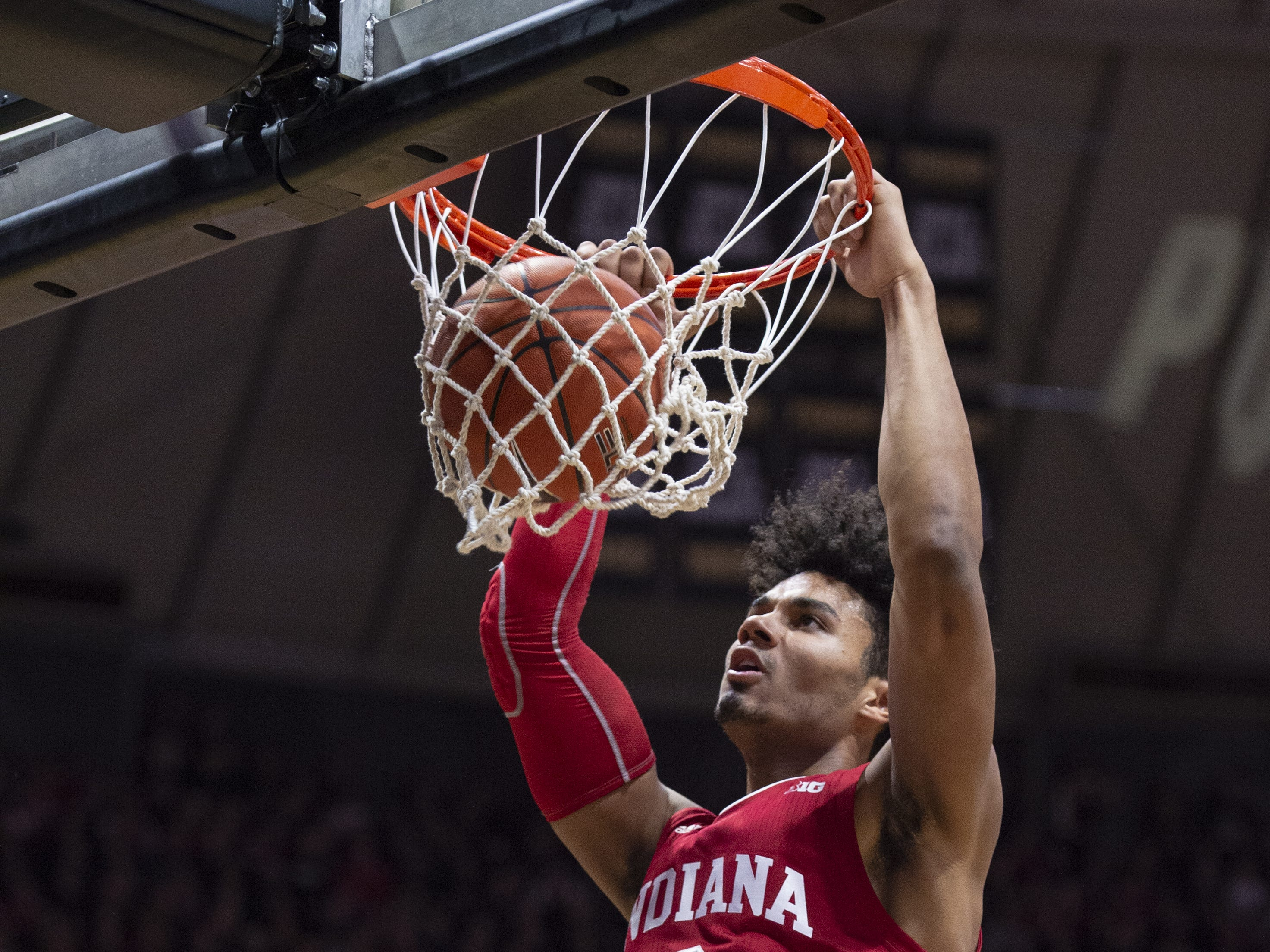 Indiana Hoosiers forward Justin Smith (3) scores with a slam dunk during the first half against Purdue.