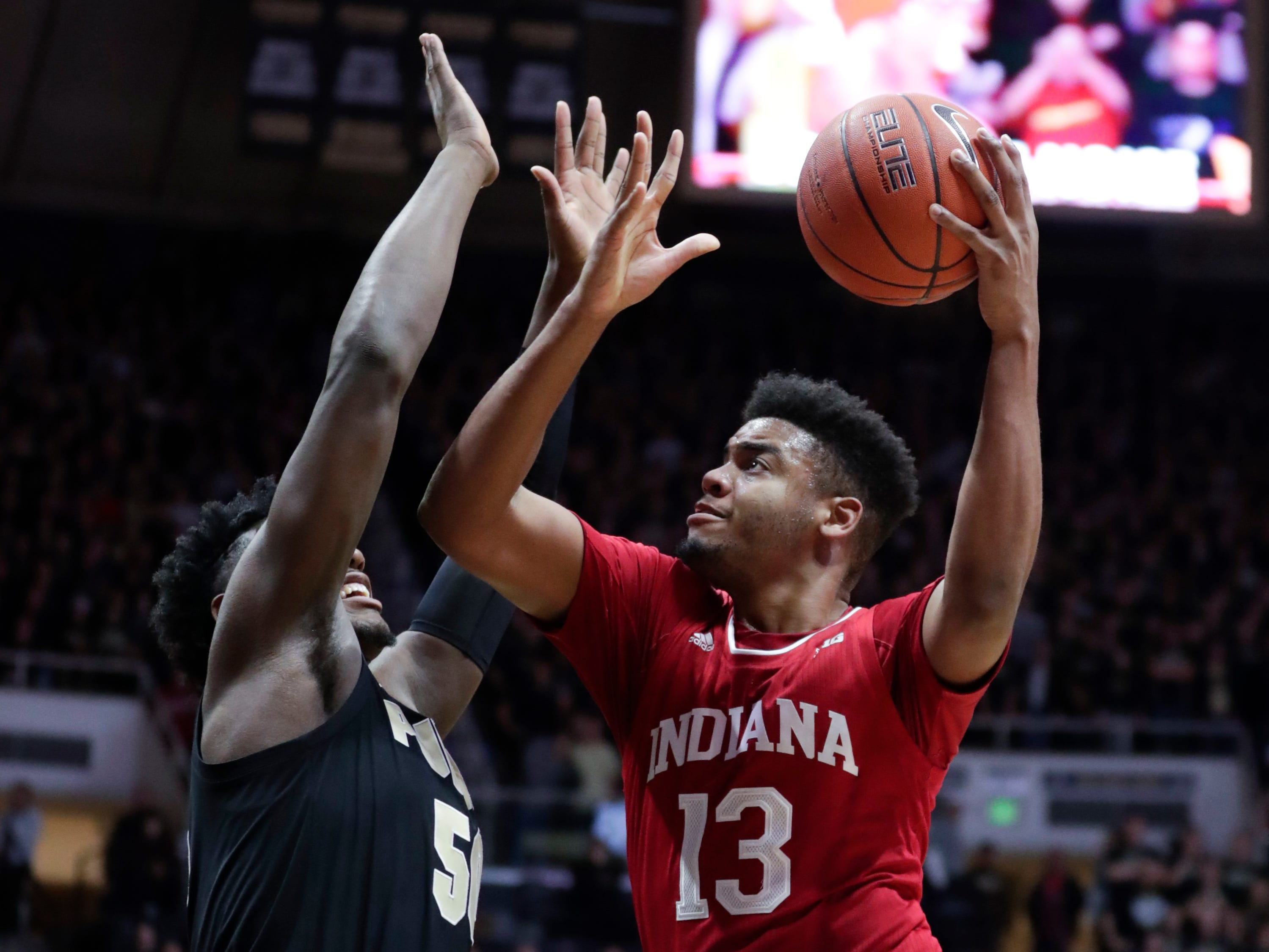 Indiana forward Juwan Morgan (13) shoots over Purdue forward Trevion Williams (50) during the first half in West Lafayette.