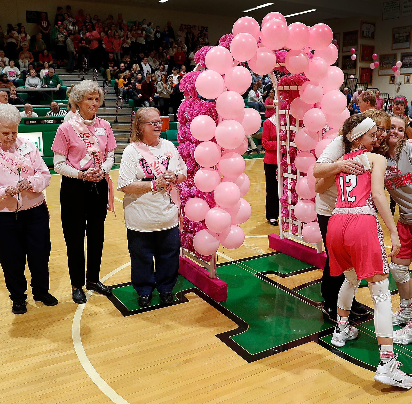 Doyel: Triton Central's 'Pink Out' game a victory for breast cancer survivors