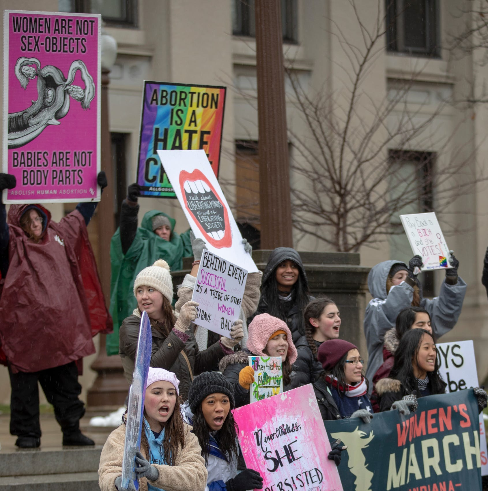 A group of anti abortion protesters are blocked by participants in the day's Women's March, Indianapolis, Saturday, Jan. 19, 2019.