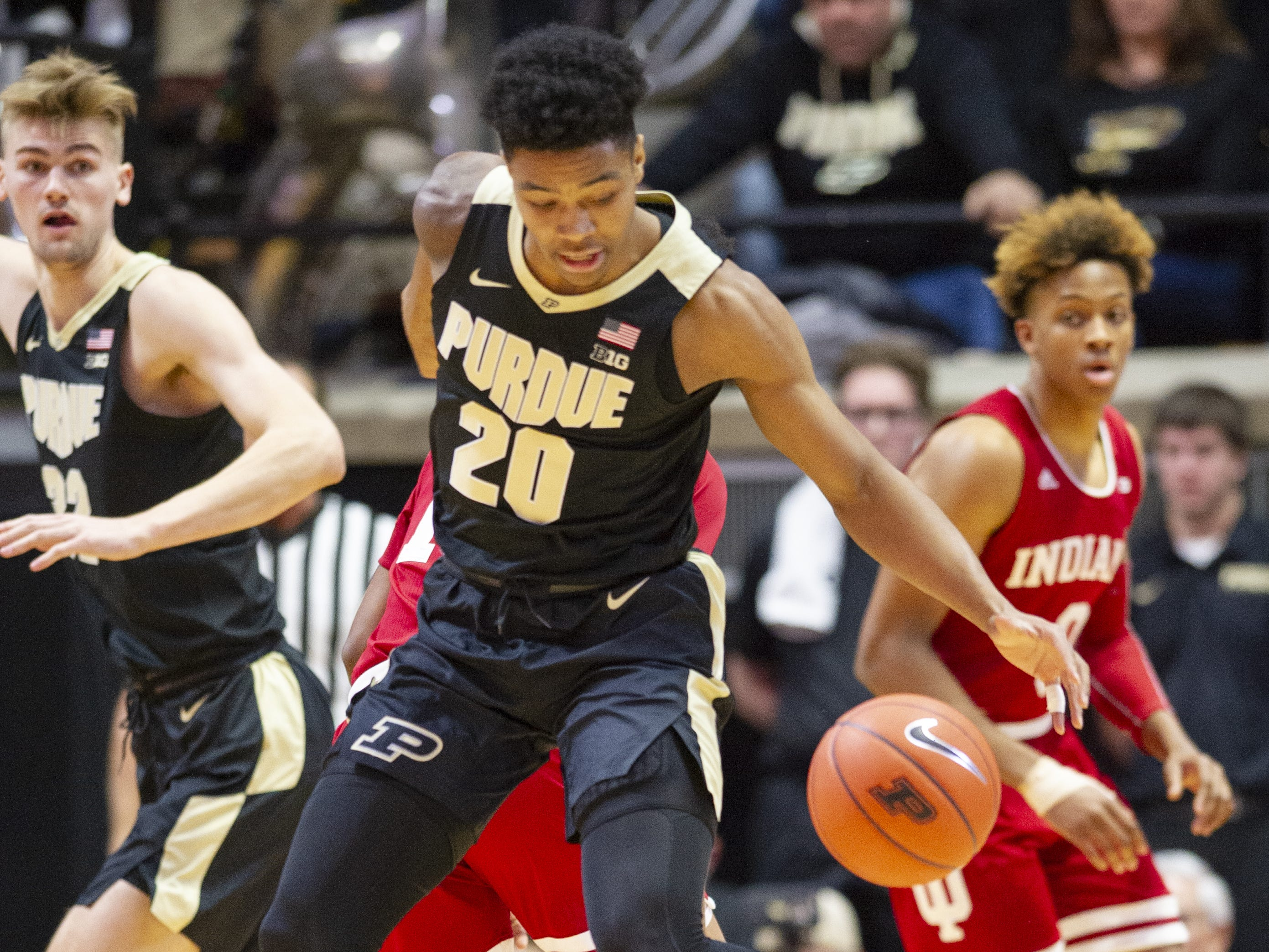Purdue Boilermakers guard Nojel Eastern (20) works to regain control of the ball during the first half against Indiana.