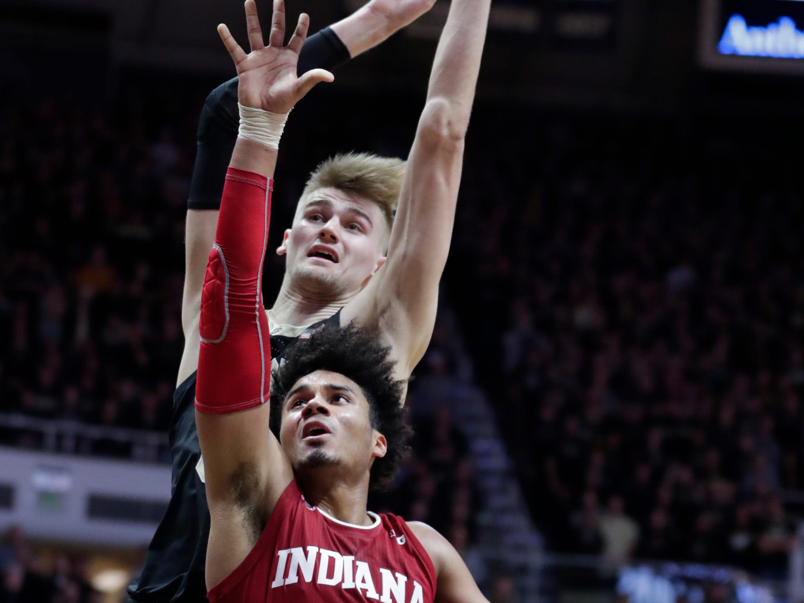 Purdue center Matt Haarms (32) comes from behind to block the shot over Indiana forward Justin Smith (3) during the first half in West Lafayette, Ind.