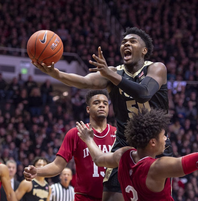 Purdue Boilermakers forward Trevion Williams (50) drives the ball through the defense of Indiana Hoosiers forward Justin Smith (3) to score during the second half of action.
