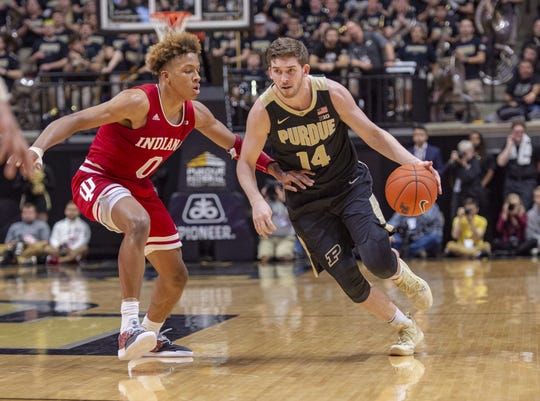 Purdue Boilermakers guard Ryan Cline (14) makes a move around the defense of Indiana Hoosiers guard Romeo Langford (0) during the second half of action.