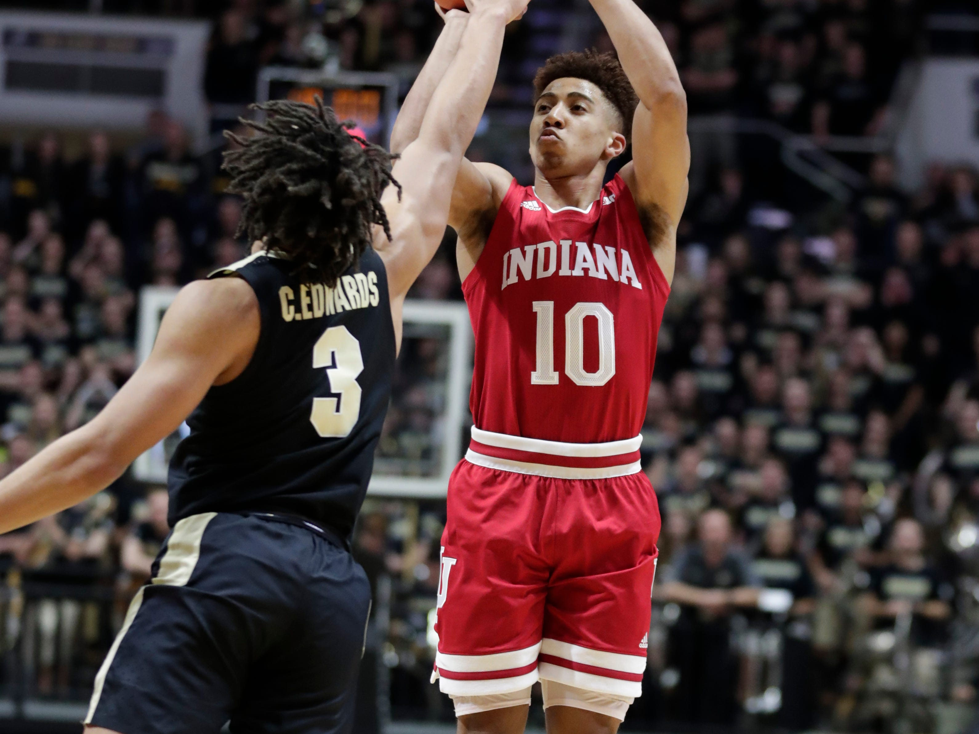 Indiana guard Rob Phinisee (10) shoots over Purdue guard Carsen Edwards (3) during the first half of an NCAA college basketball game in West Lafayette, Ind., Saturday, Jan. 19, 2019. (AP Photo/Michael Conroy)