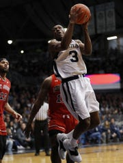 Butler Bulldogs guard Kamar Baldwin (3) drives around St. John's Red Storm guard Bryan Trimble Jr. (12) in the first half of their game at Hinkle Fieldhouse Saturday, Jan. 19, 2019.