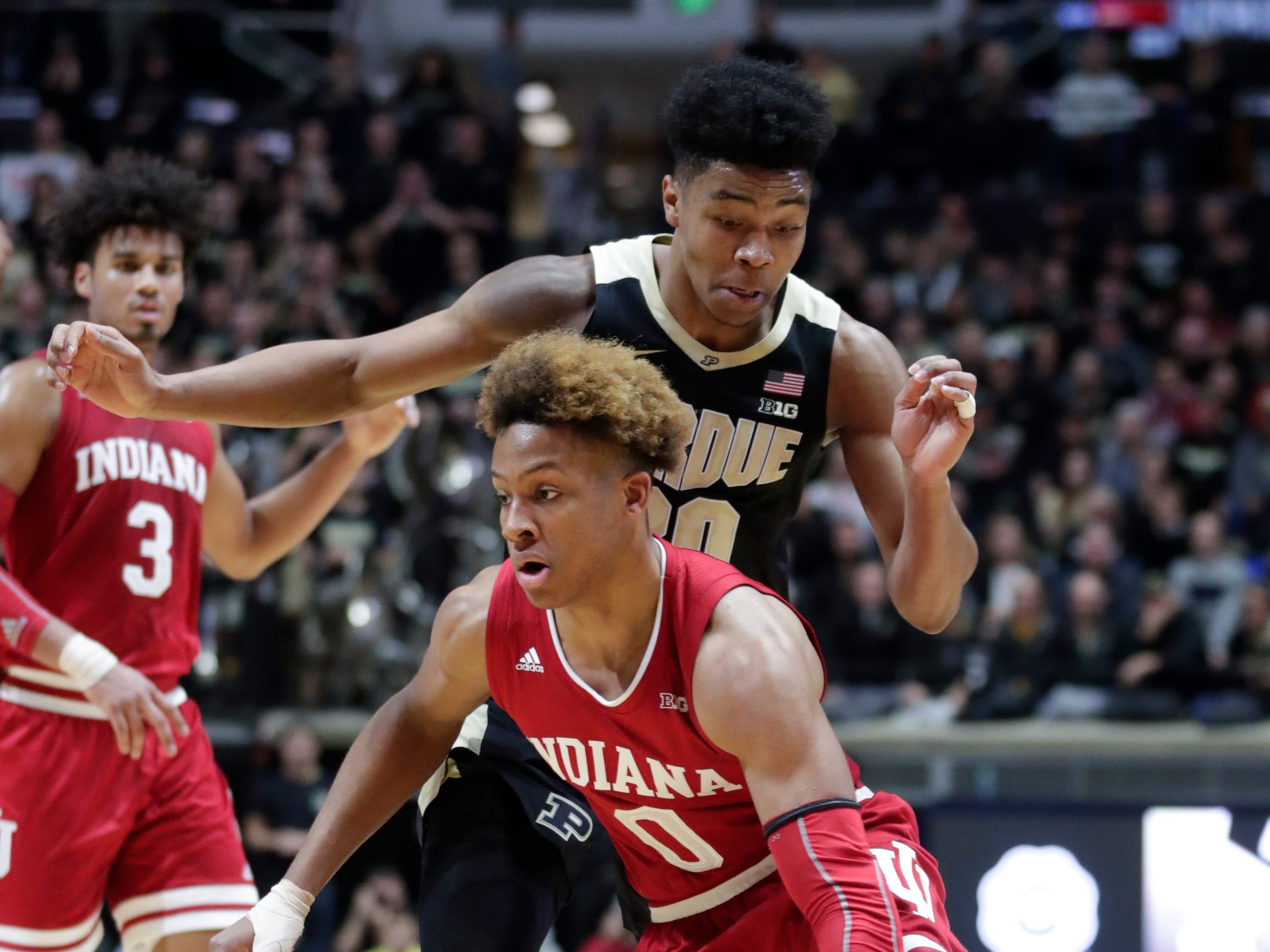 Indiana guard Romeo Langford (0) cuts in front of Purdue guard Nojel Eastern (20) during the first half in West Lafayette.