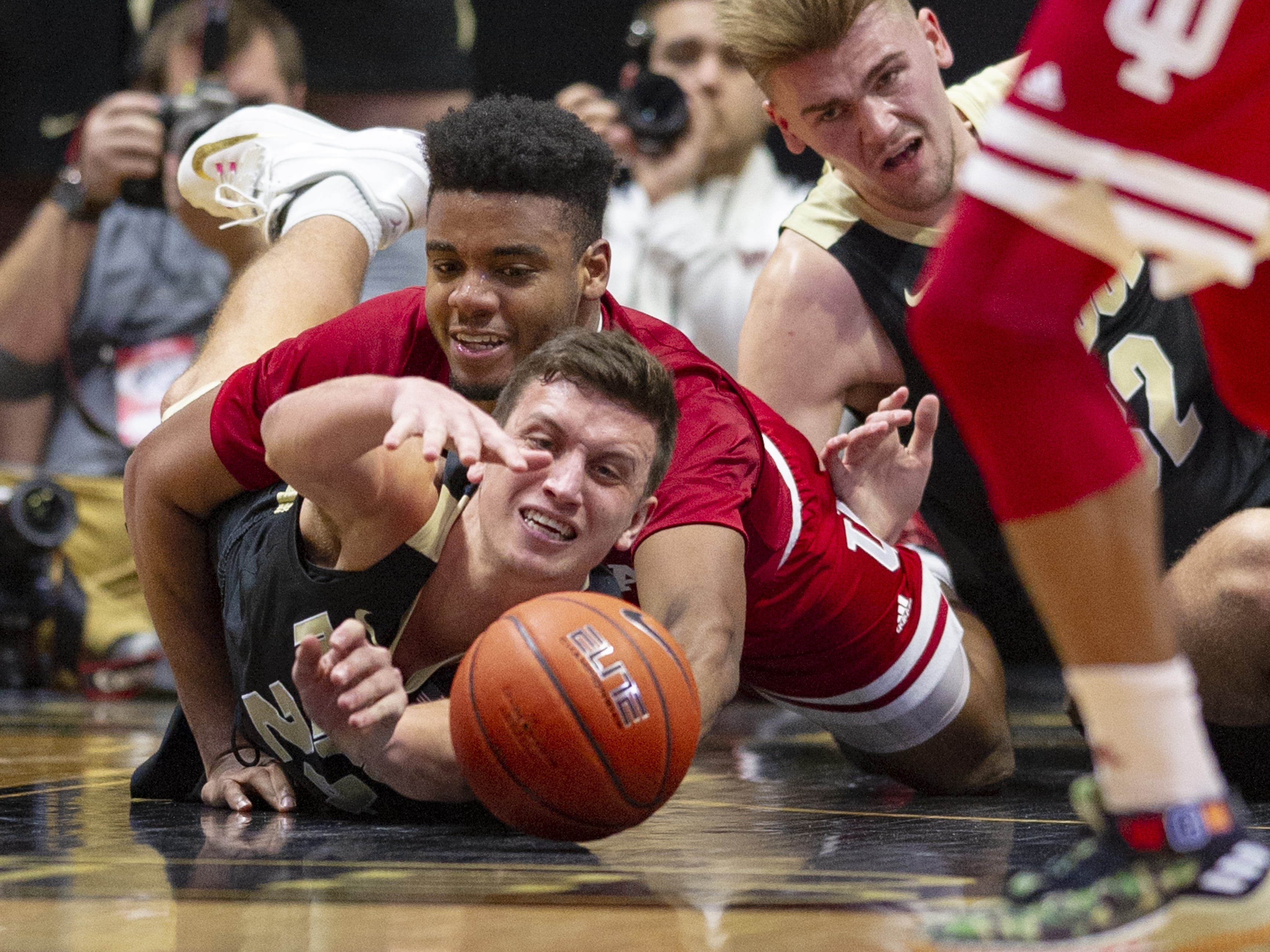 Purdue Boilermakers forward Grady Eifert (24) and Indiana Hoosiers forward Juwan Morgan (13) battle for a loose ball during the second half of action.