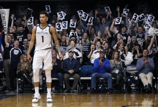 The Butler Bulldogs fans celebrate a Jordan Tucker (1) three-pointer in the first half of their game at Hinkle Fieldhouse Saturday, Jan. 19, 2019.