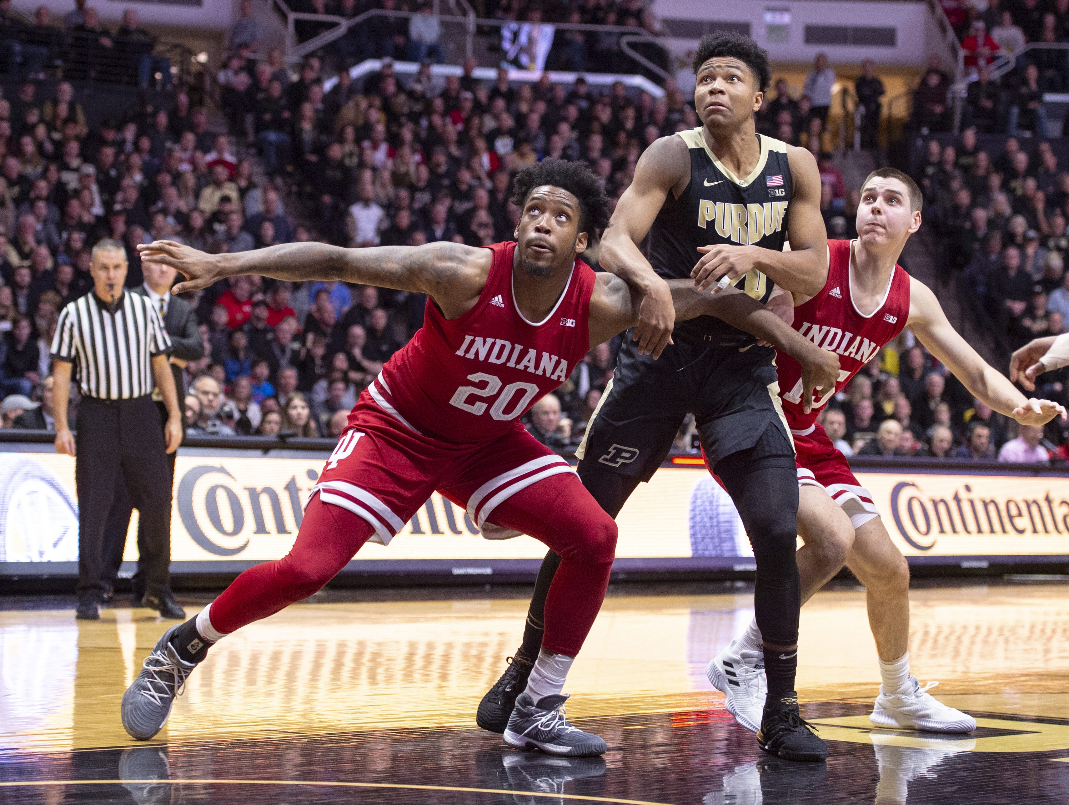 Indiana Hoosiers forward De'Ron Davis (20), leftest and guard Zach McRoberts (15) battle Purdue Boilermakers guard Nojel Eastern (20) for position during the second half of action. Purdue hosted Indiana in a BigTen men's basketball matchup, Saturday, Jan. 19, 2019. Purdue won 70-55.