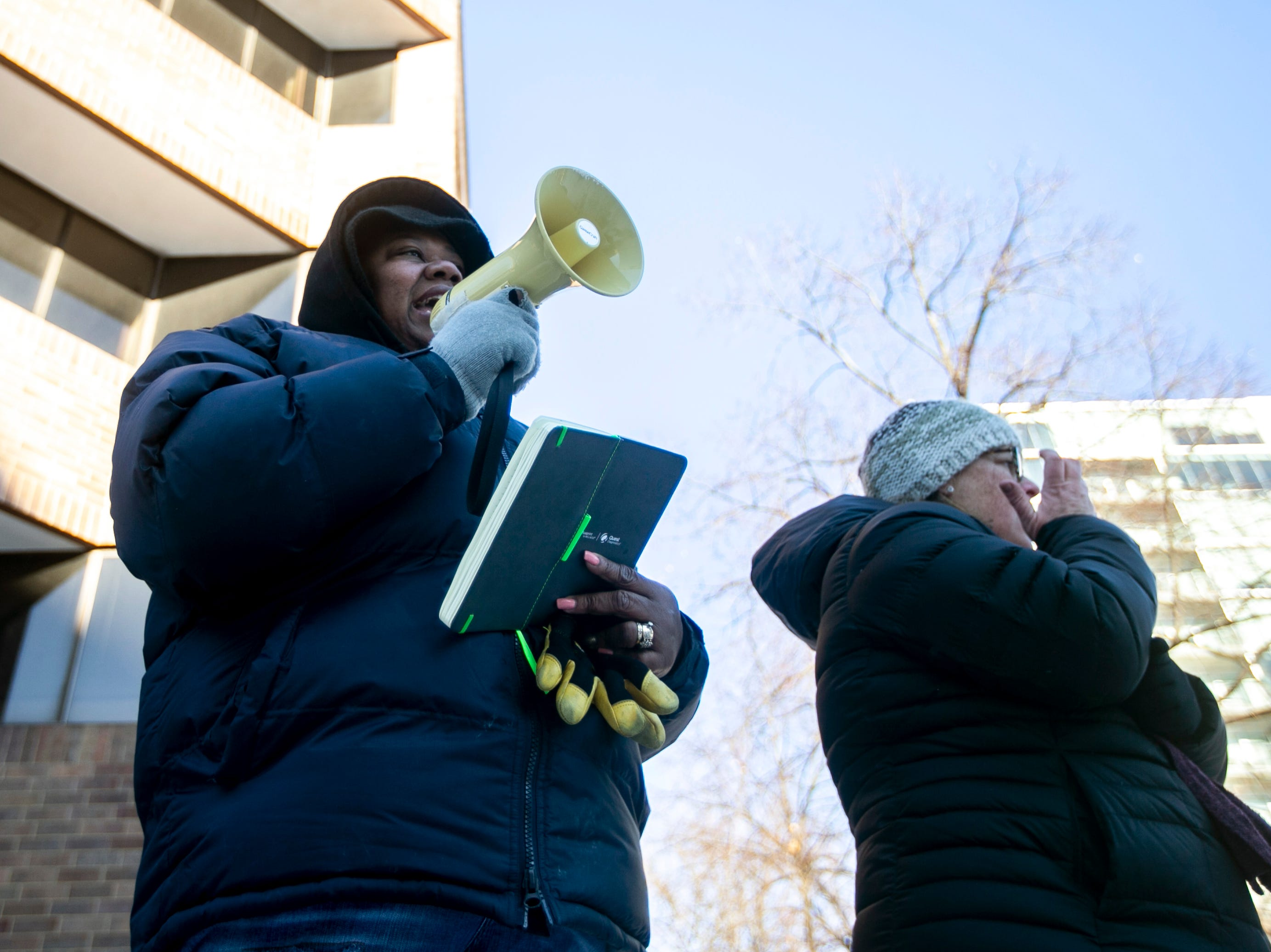 "Johnson County supervisor Royceann Porter, left, speaks during the ""Women's March"" on Saturday, Jan. 19, 2019, along the pedestrian mall in downtown Iowa City, Iowa."
