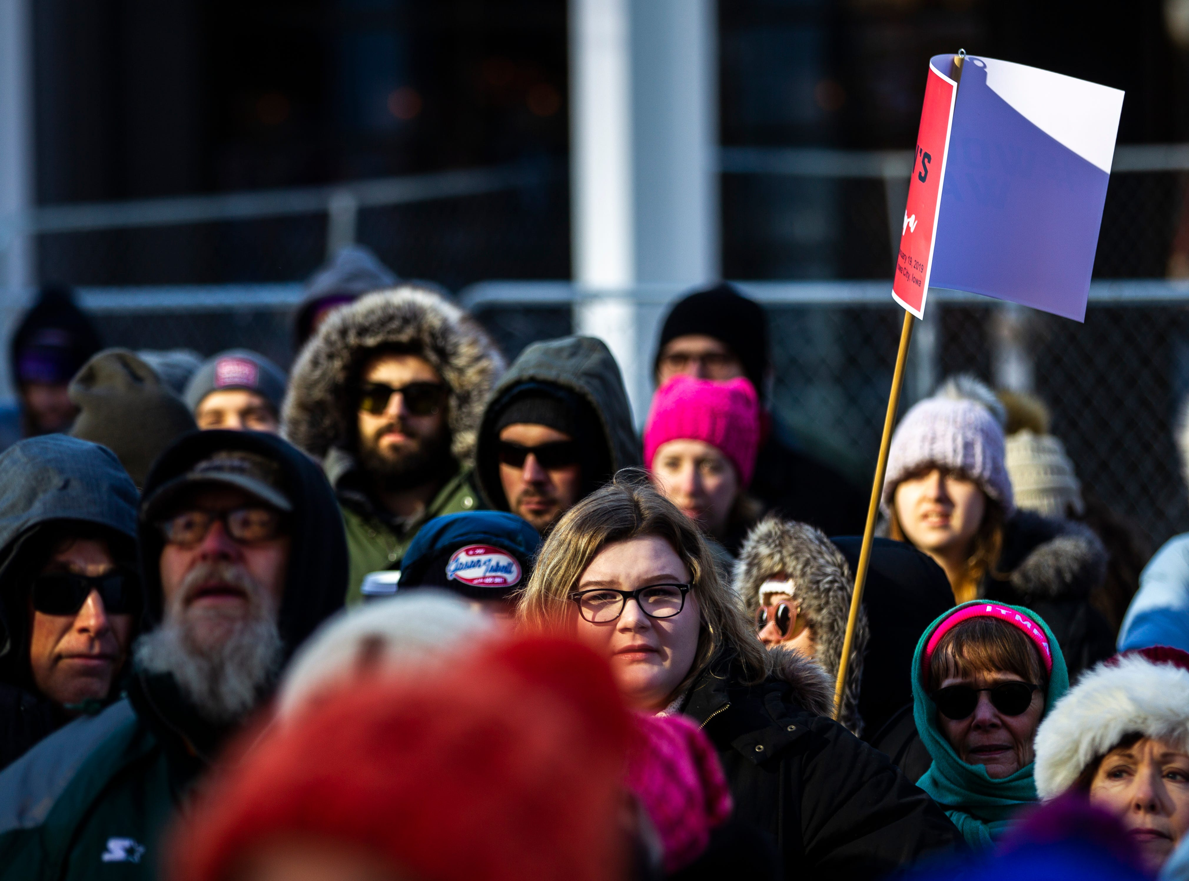 "Community members gather during the ""Women's March"" on Saturday, Jan. 19, 2019, along the pedestrian mall in downtown Iowa City, Iowa."