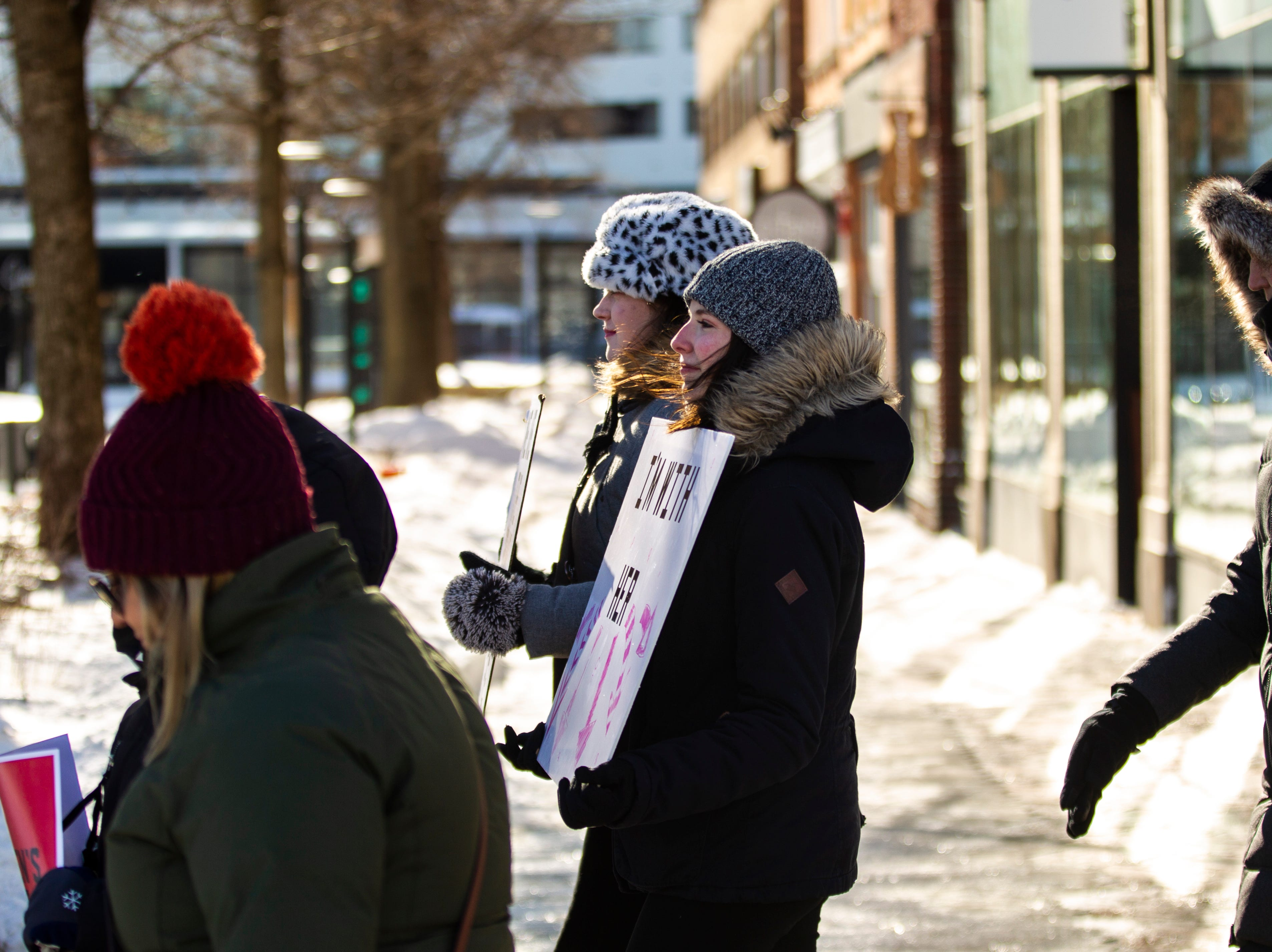 "Community members protest during the ""Women's March"" on Saturday, Jan. 19, 2019, along the pedestrian mall in downtown Iowa City, Iowa."