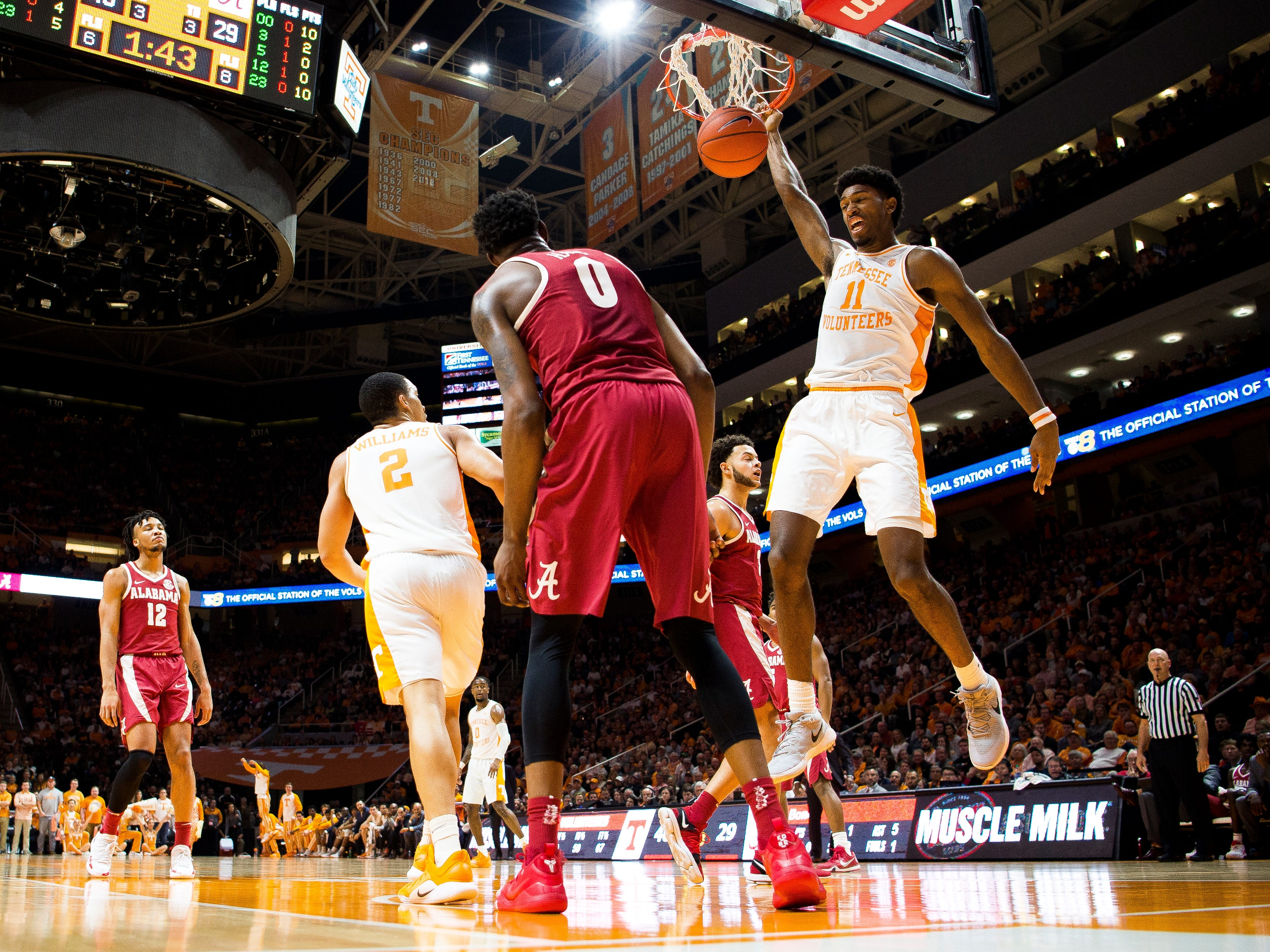 Tennessee forward Kyle Alexander (11) dunks the ball during the first half of Tennessee's home SEC conference game against Alabama at Thompson-Boling Arena in Knoxville on Saturday, January 19, 2019.