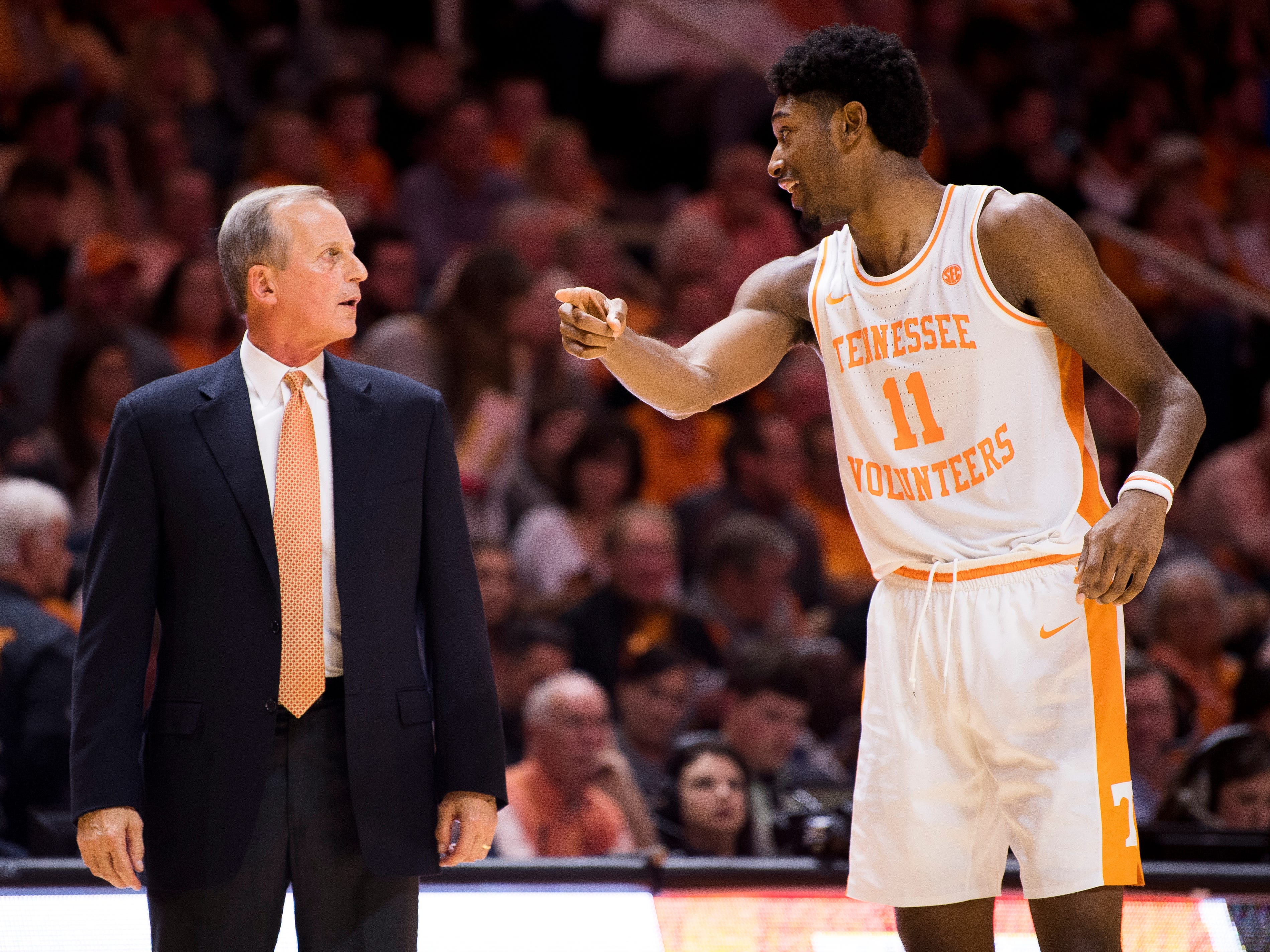 Tennessee Head Coach Rick Barnes speaks with Tennessee forward Kyle Alexander (11) during the second half of Tennessee's home SEC conference game against Alabama at Thompson-Boling Arena in Knoxville on Saturday, January 19, 2019.