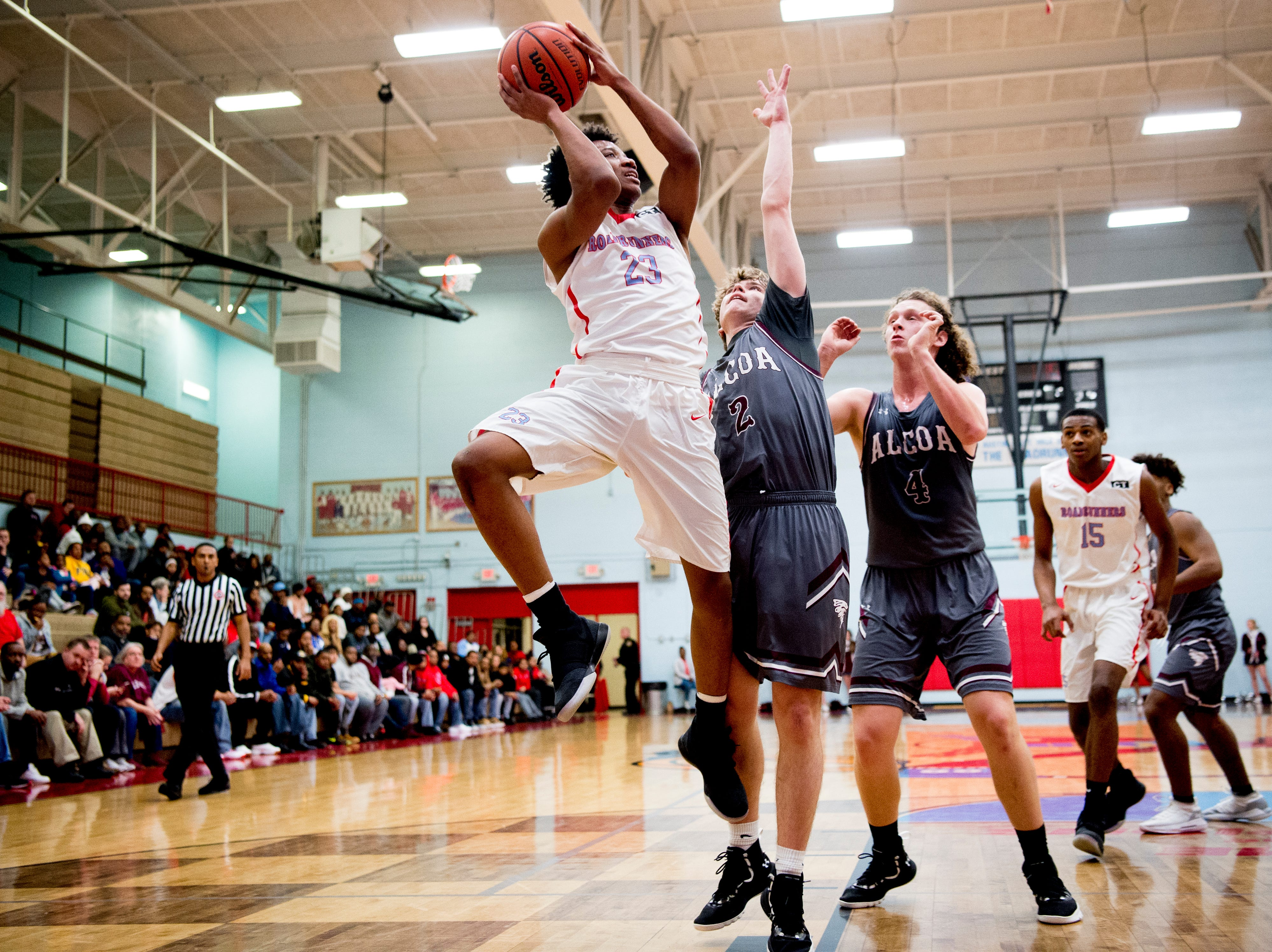 Austin-East's LaRon Dixon (23) shoots the ball as Alcoa's during a game between Austin-East and Alcoa at Austin-East High School in Knoxville, Tennessee on Friday, January 18, 2019.