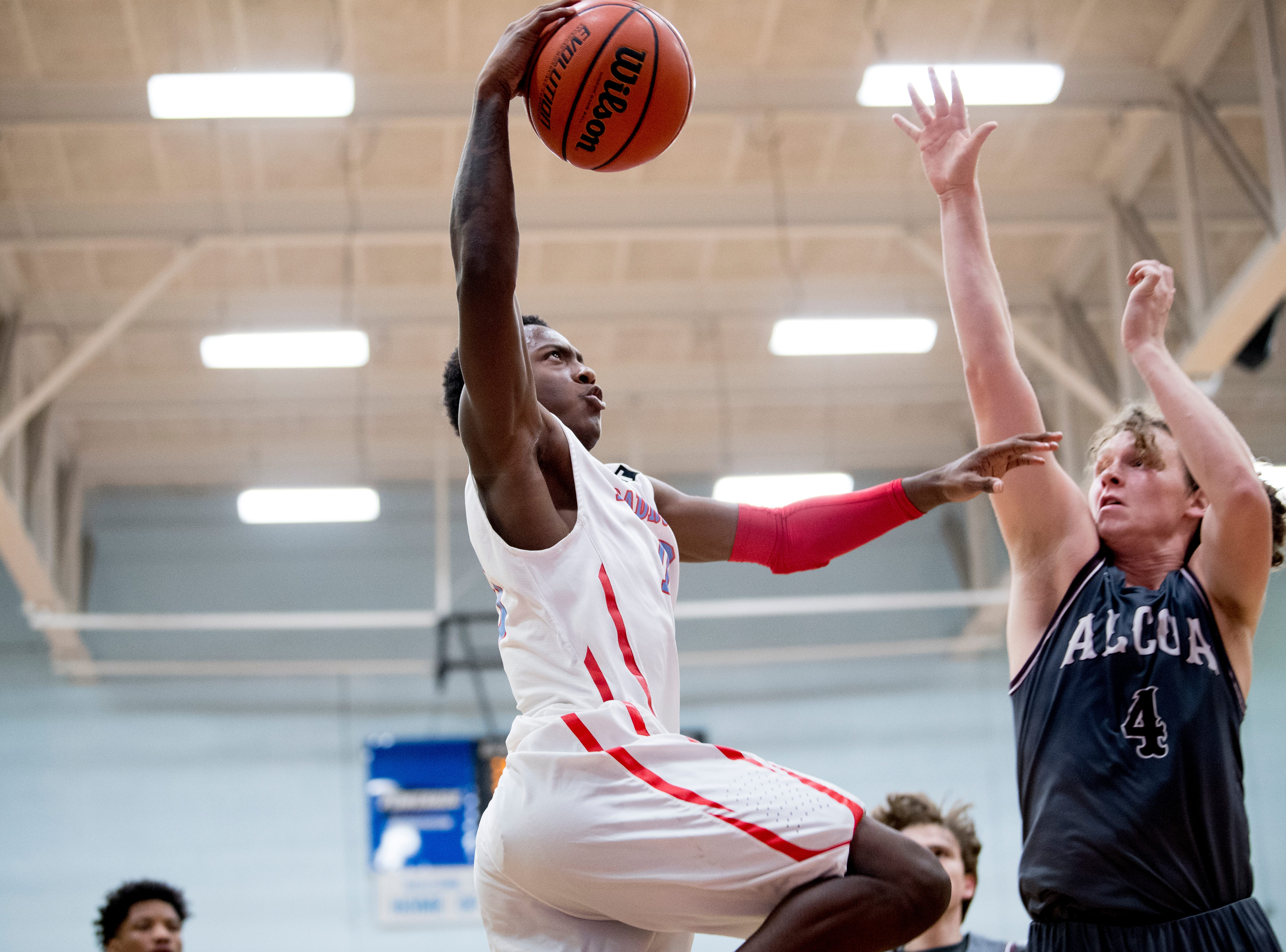 Austin-East's Derrion Battle (10) goes for a layup as Alcoa's  Nick Roberts (4) defends during a game between Austin-East and Alcoa at Austin-East High School in Knoxville, Tennessee on Friday, January 18, 2019.