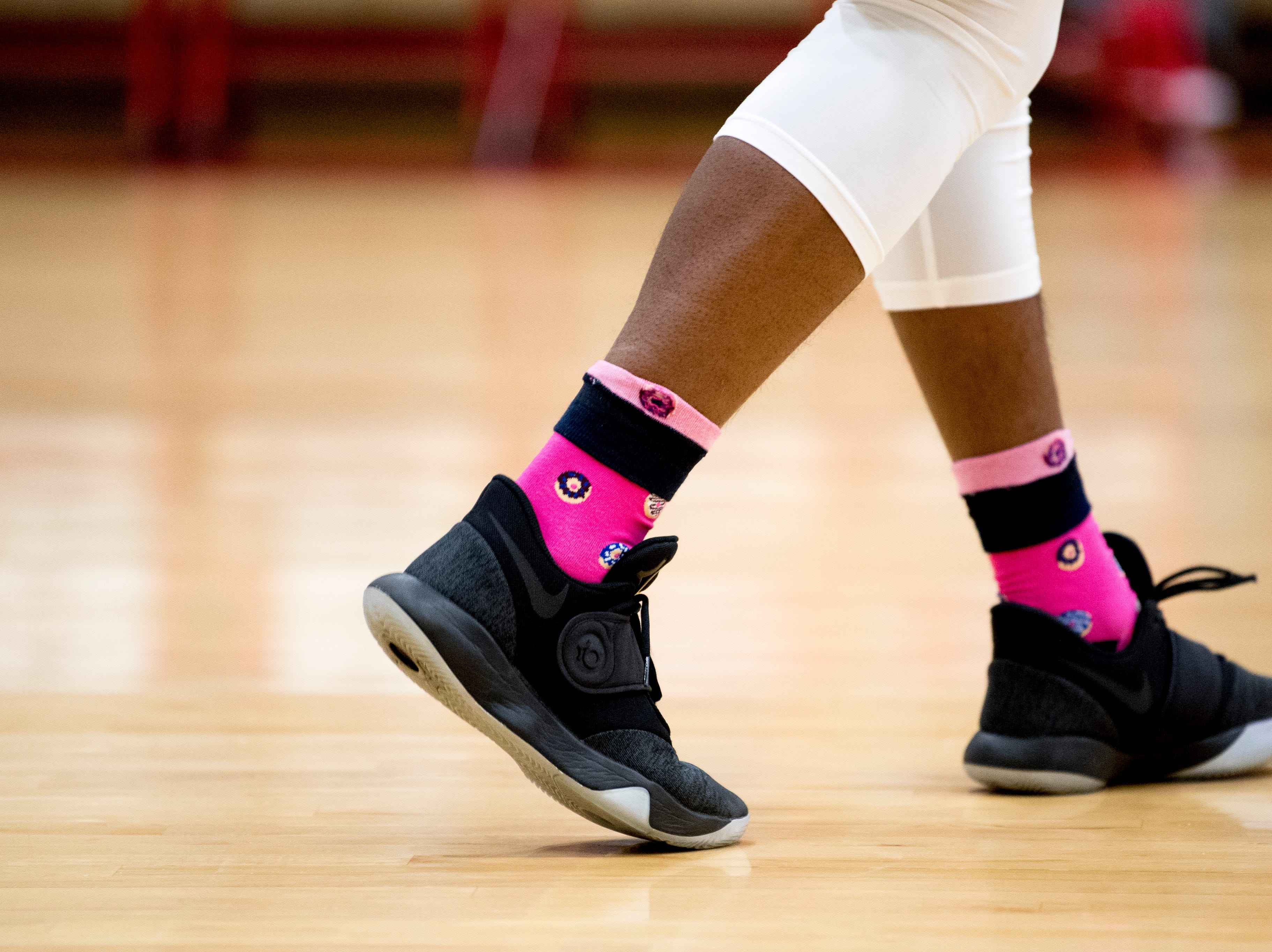 An Austin-East player wears donut printed socks during a game between Austin-East and Alcoa at Austin-East High School in Knoxville, Tennessee on Friday, January 18, 2019.