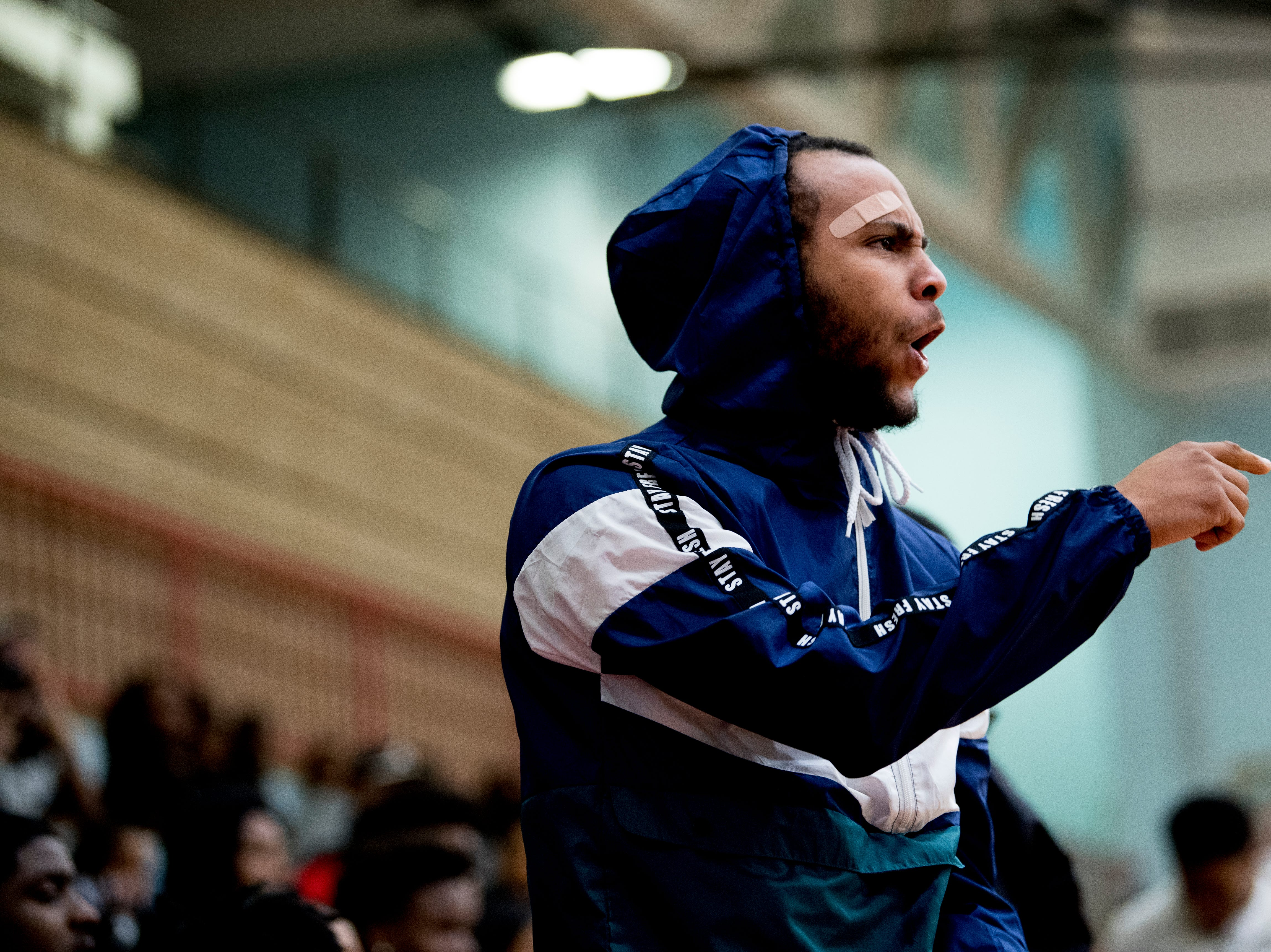 An Austin-East fan yells at the referee after a call during a game between Austin-East and Alcoa at Austin-East High School in Knoxville, Tennessee on Friday, January 18, 2019.