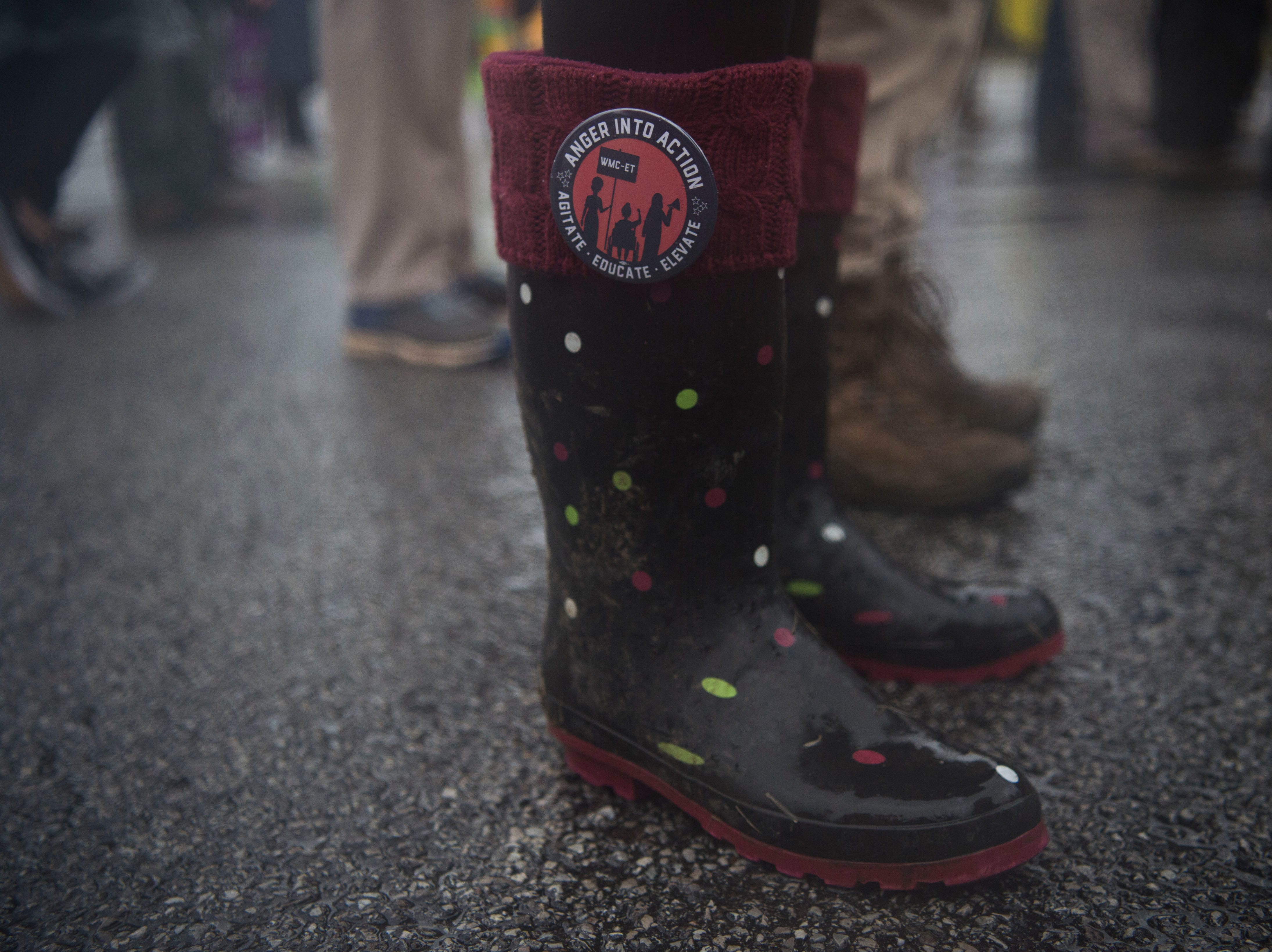 A pin is attached to an attendees boots during the 2019 Women's March in Chilhowee Park Saturday, Jan. 19, 2019.