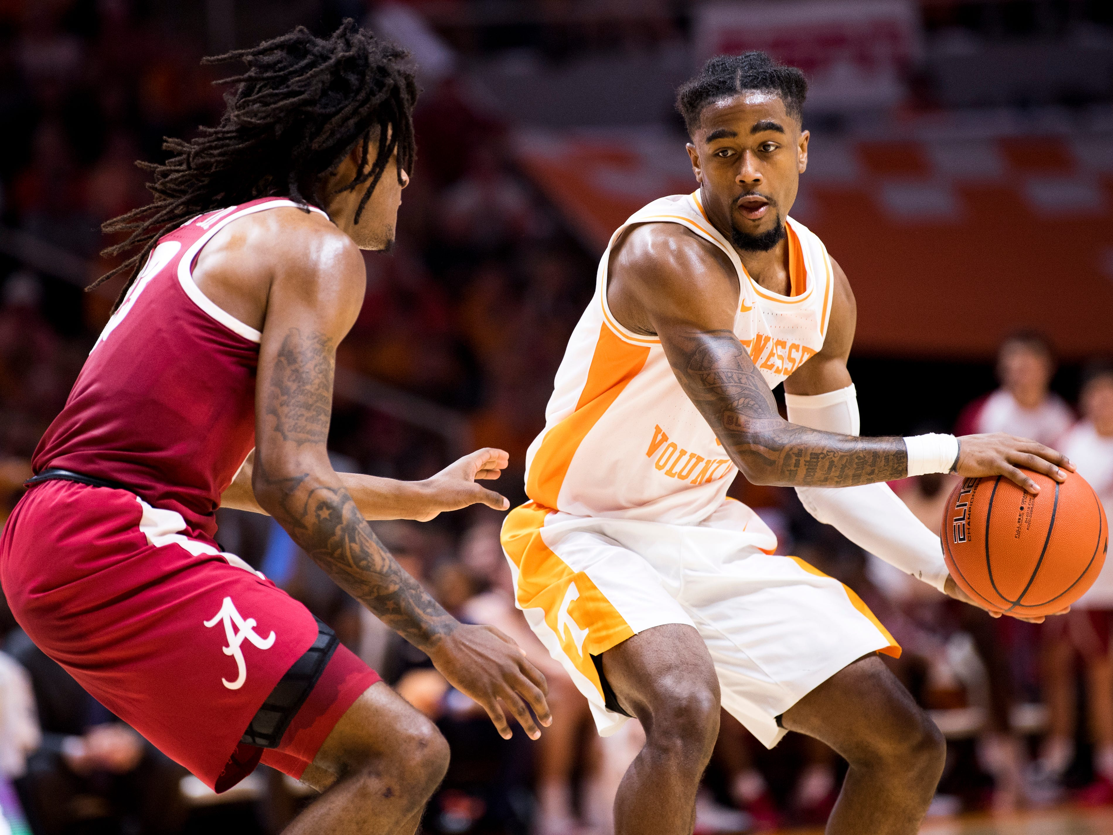 Tennessee guard Jordan Bone (0) moves down court during the second half of Tennessee's home SEC conference game against Alabama at Thompson-Boling Arena in Knoxville on Saturday, January 19, 2019.
