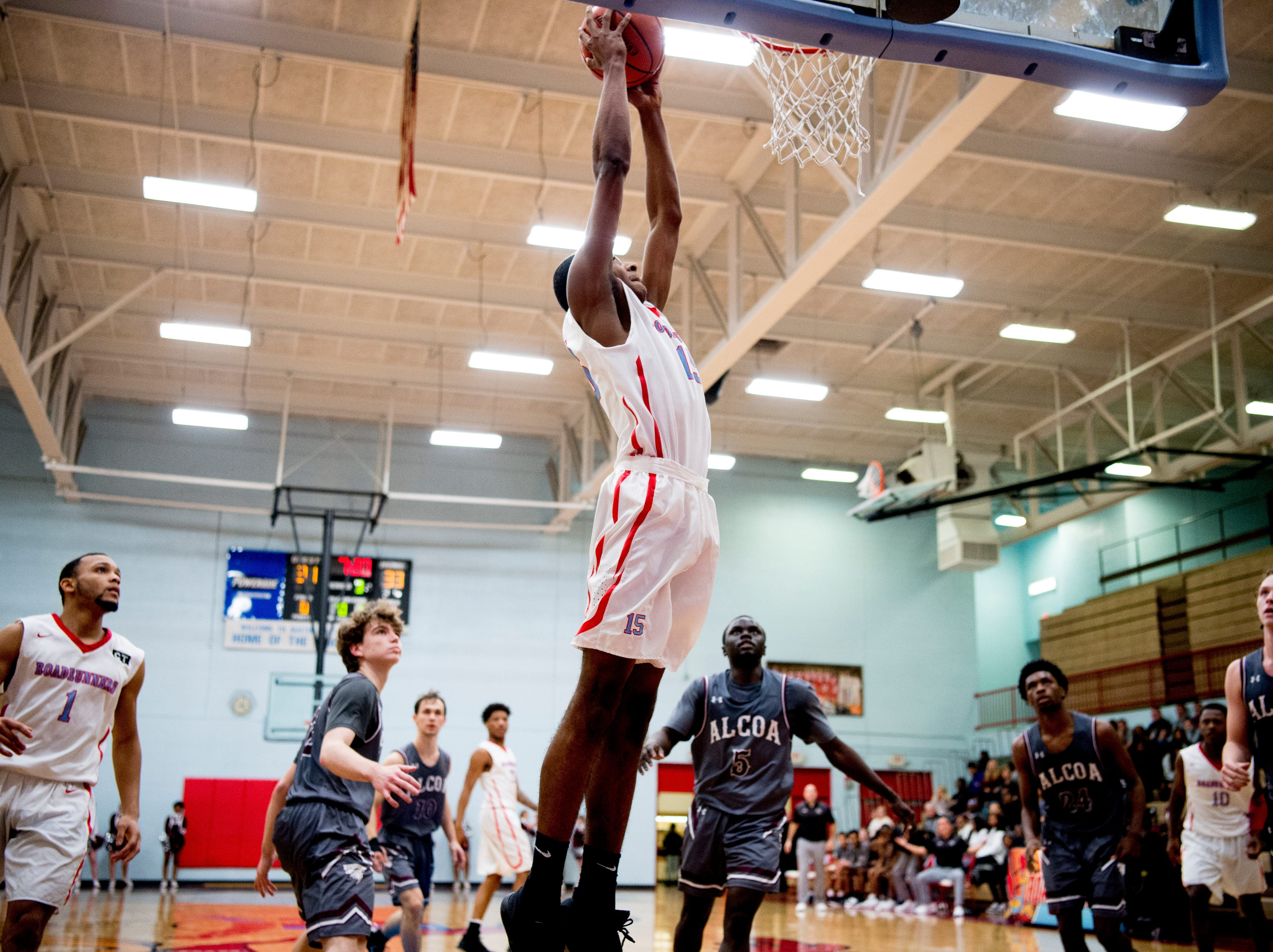 Austin-East's Ka'Juan Bullard (15) goes for a dunk during a game between Austin-East and Alcoa at Austin-East High School in Knoxville, Tennessee on Friday, January 18, 2019.