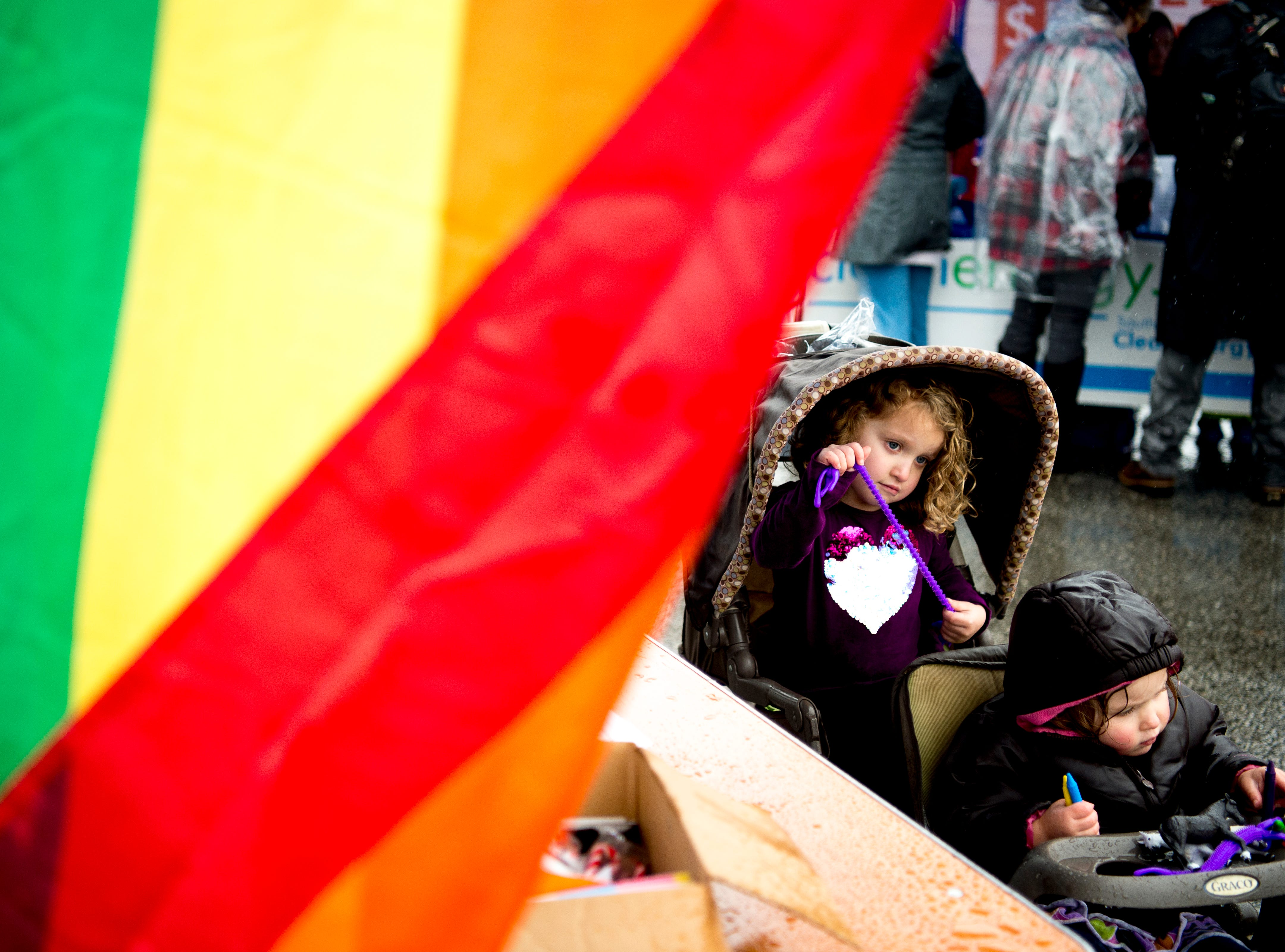 Kids stay busy under a tent at the 2019 Knoxville Women's March at Chilhowee Park in Knoxville, Tennessee on Saturday, January 19, 2019.
