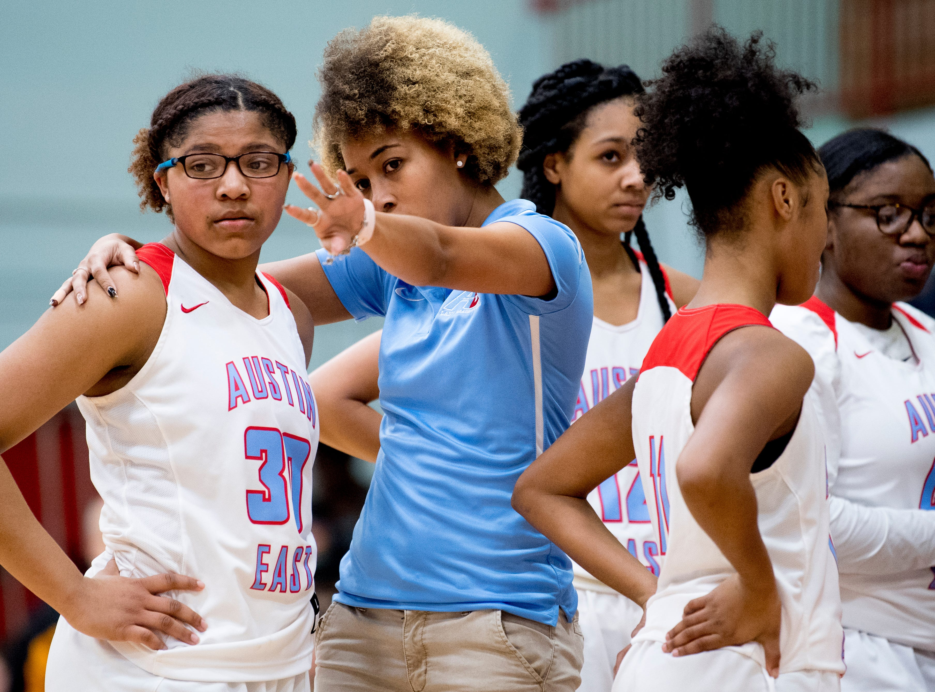 Austin-East's Ahya Moreno (30) gets some tips from Coach Jalan Harper during a game between Austin-East and Alcoa at Austin-East High School in Knoxville, Tennessee on Friday, January 18, 2019.