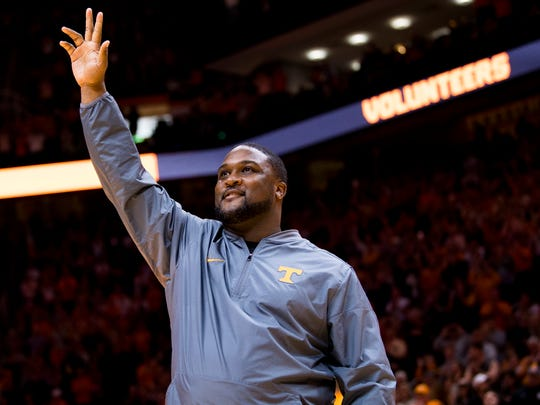 New Tennessee football assistant coach Tee Martin waves to the crowd during the first half of Tennessee's home SEC conference game against Alabama at Thompson-Boling Arena in Knoxville on Saturday, January 19, 2019.
