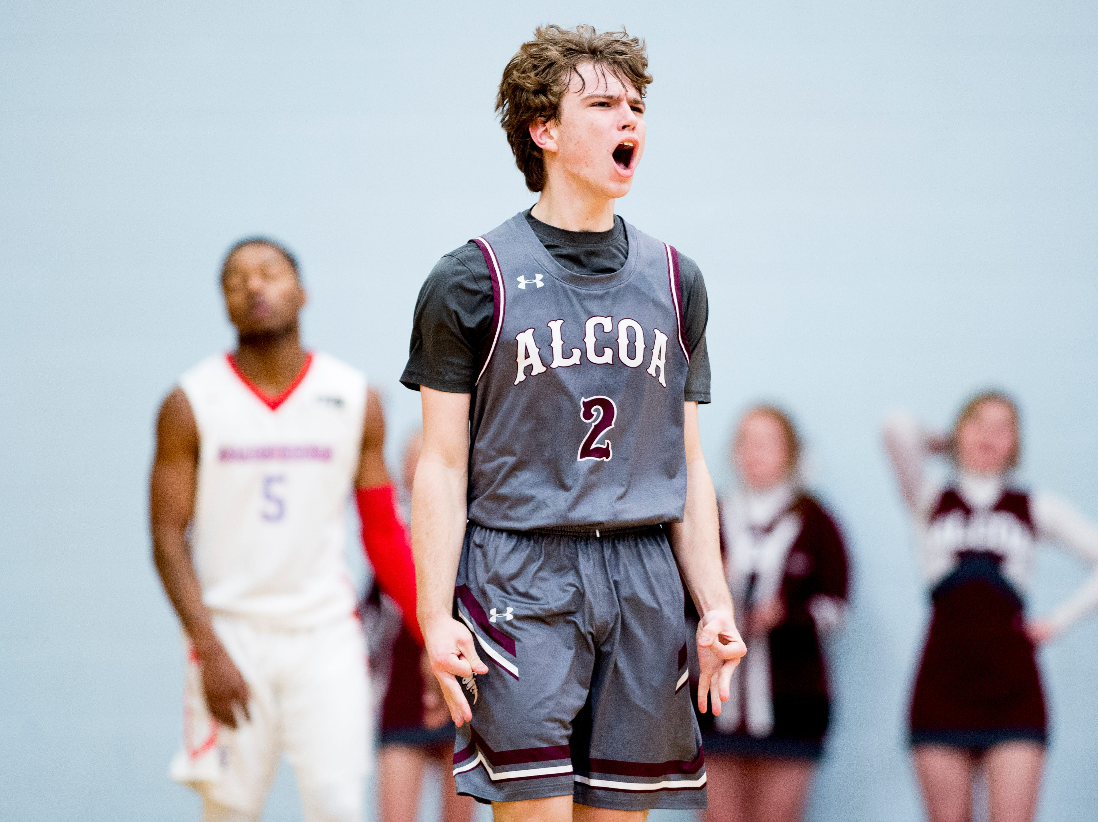 Alcoa's Garrett Rogers (2) reacts after making a three point shot during a game between Austin-East and Alcoa at Austin-East High School in Knoxville, Tennessee on Friday, January 18, 2019.