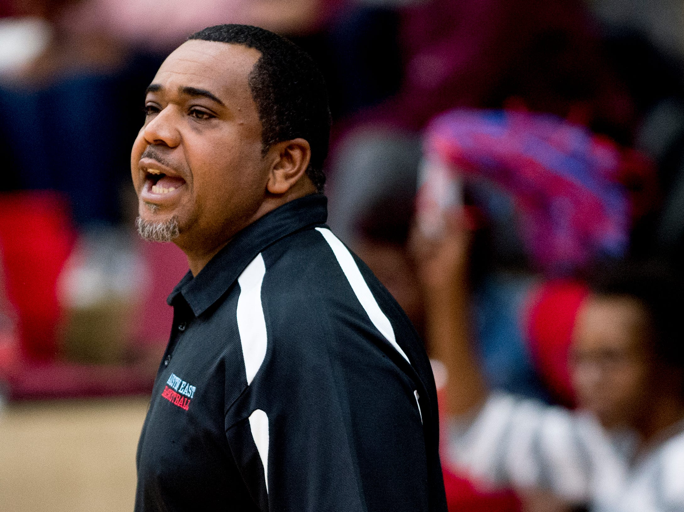Austin-East Head Coach Marcus Stanton calls during a game between Austin-East and Alcoa at Austin-East High School in Knoxville, Tennessee on Friday, January 18, 2019.