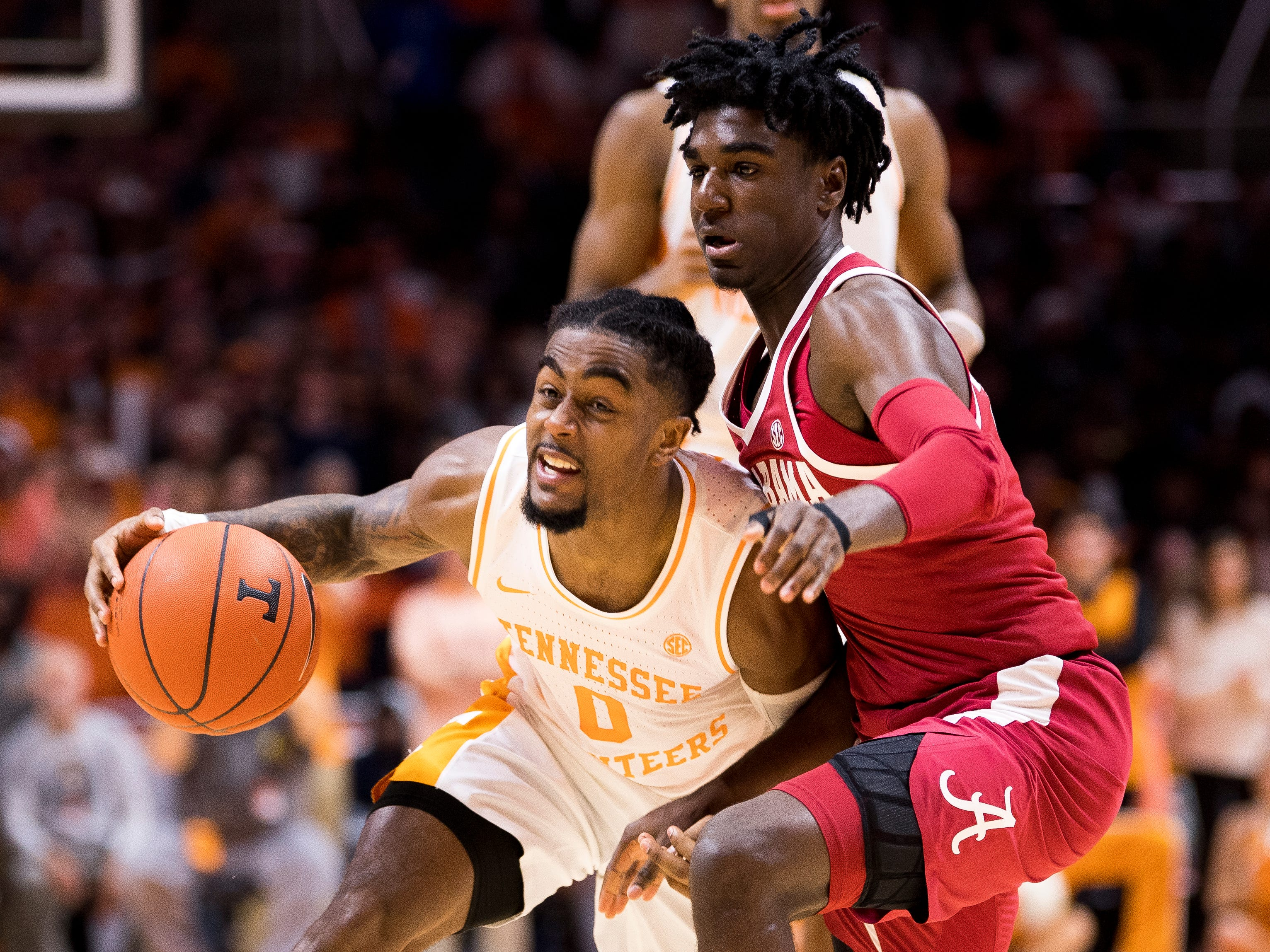 Tennessee guard Jordan Bone (0) moves down court during the first half of Tennessee's home SEC conference game against Alabama at Thompson-Boling Arena in Knoxville on Saturday, January 19, 2019.