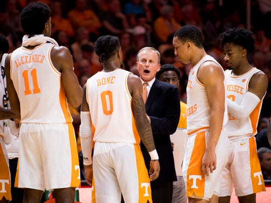 Tennessee Head Coach Rick Barnes speaks with his team during the second half of Tennessee's home SEC conference game against Alabama at Thompson-Boling Arena in Knoxville on Saturday, January 19, 2019.