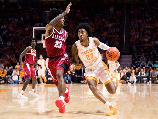 Tennessee guard Jordan Bowden (23) moves past Alabama guard John Petty (23) during the second half of Tennessee's home SEC conference game against Alabama at Thompson-Boling Arena in Knoxville on Saturday, January 19, 2019.