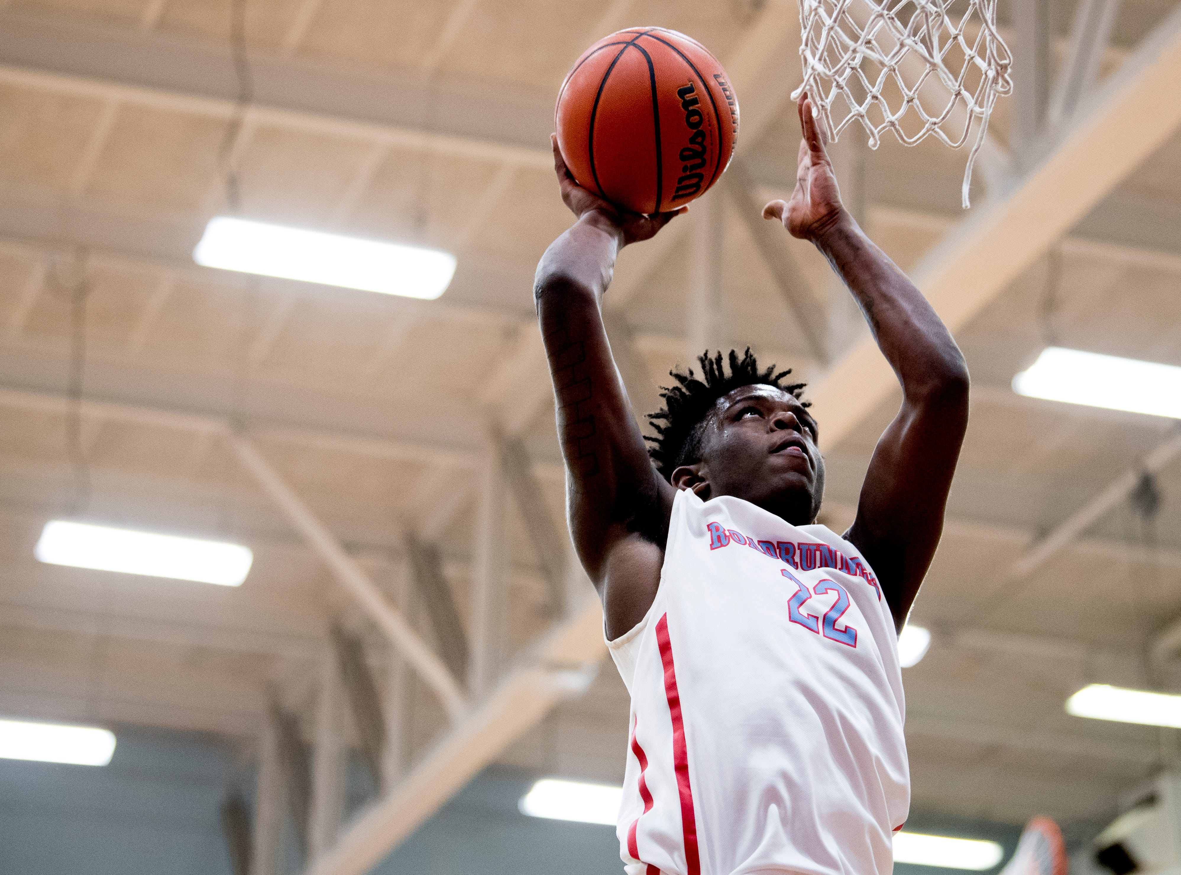 Austin-East's Derrell Upton (22) shoots a point during a game between Austin-East and Alcoa at Austin-East High School in Knoxville, Tennessee on Friday, January 18, 2019.