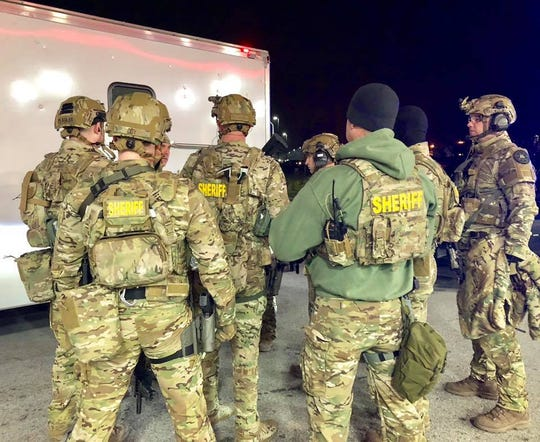 SWAT deputies plan during a police standoff in Loudon County in which a Morristown man was arrested on Saturday, Jan. 19.