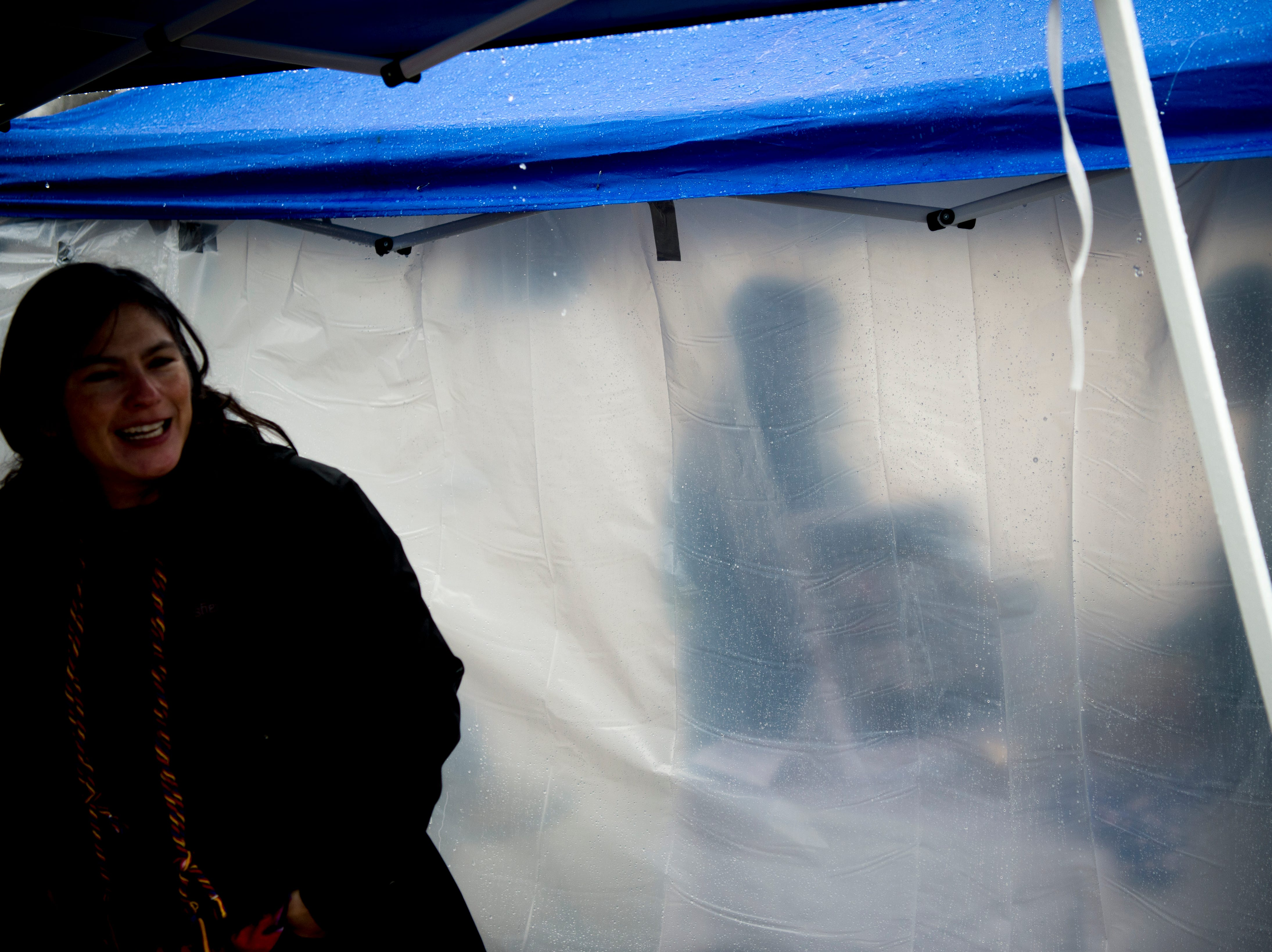 Demonstrator stay dry under tents at the 2019 Knoxville Women's March at Chilhowee Park in Knoxville, Tennessee on Saturday, January 19, 2019.