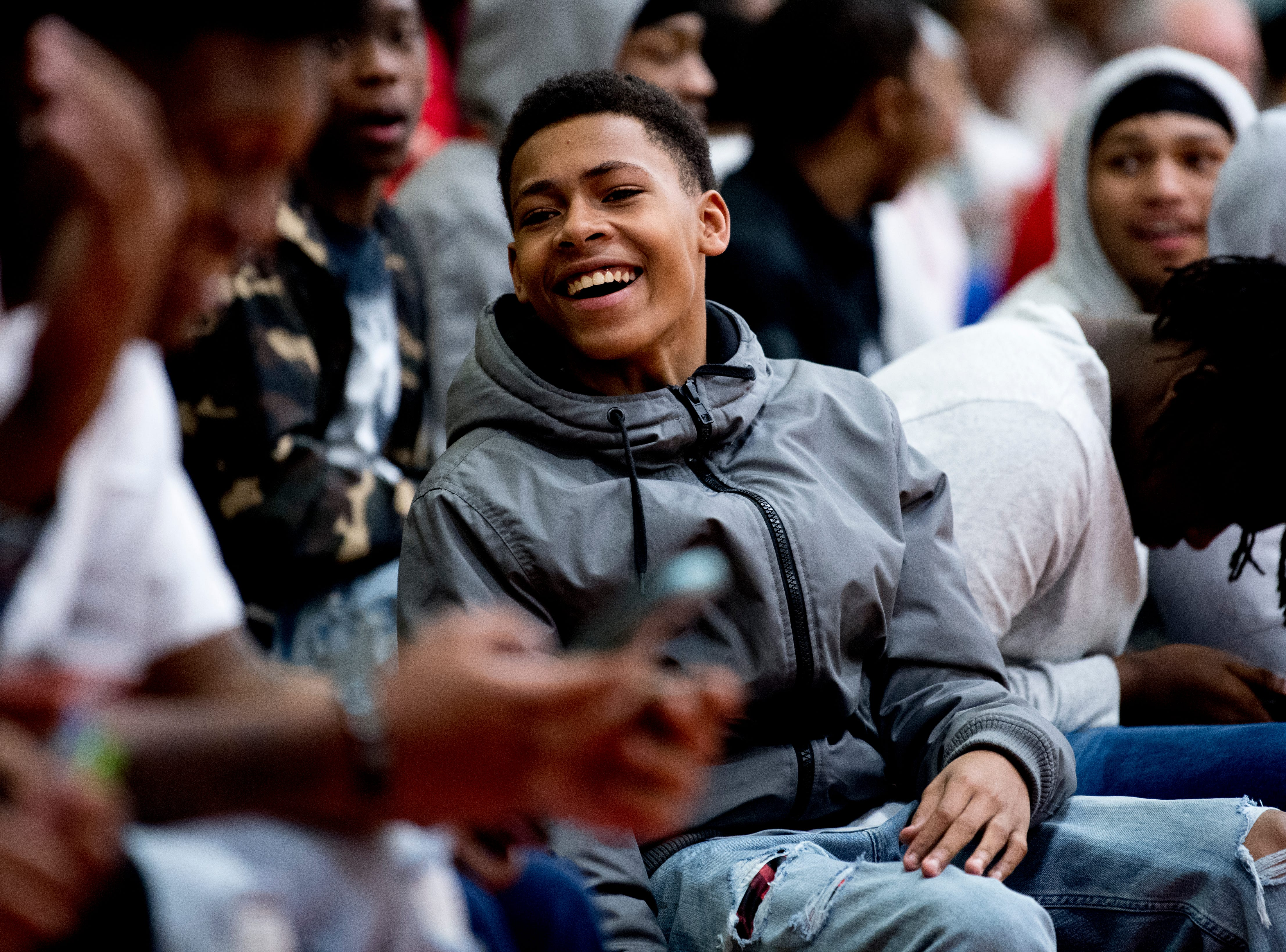 Austin-East fans share a laugh in the stands during a game between Austin-East and Alcoa at Austin-East High School in Knoxville, Tennessee on Friday, January 18, 2019.