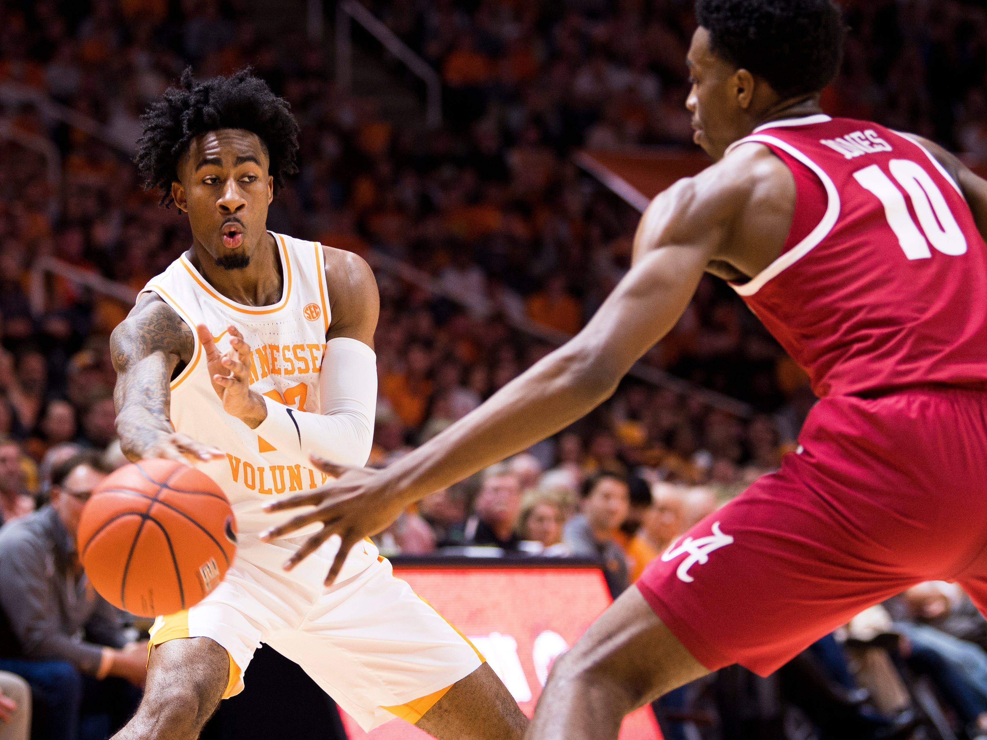 Tennessee guard Jordan Bowden (23) passes the ball off to a teammate during the first half of Tennessee's home SEC conference game against Alabama at Thompson-Boling Arena in Knoxville on Saturday, January 19, 2019.